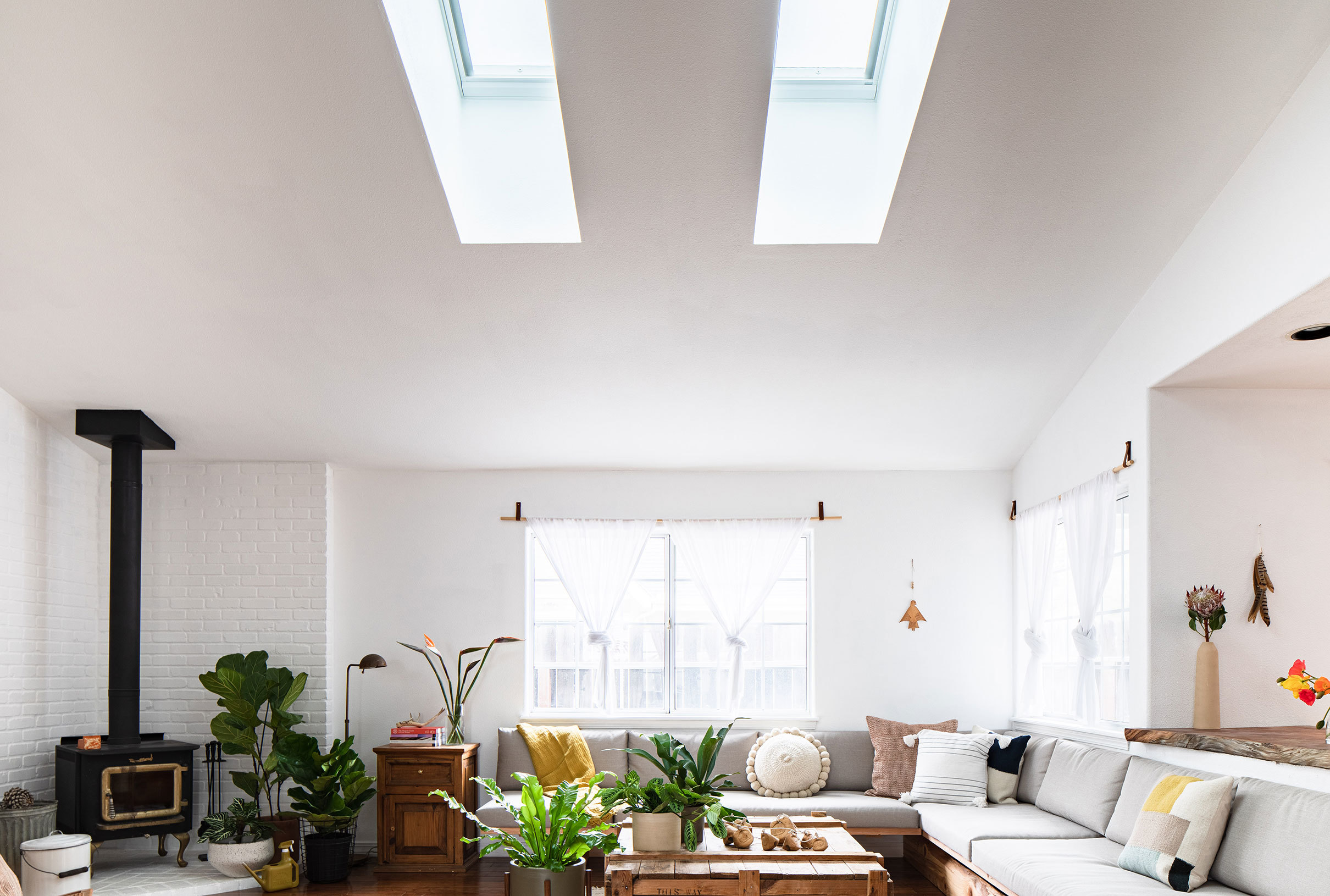 A living room with two skylights sectional sofa
