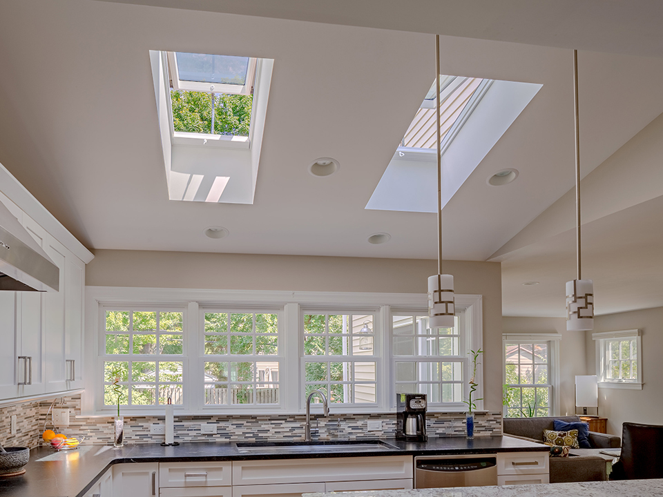 Grey and white kitchen with skylights