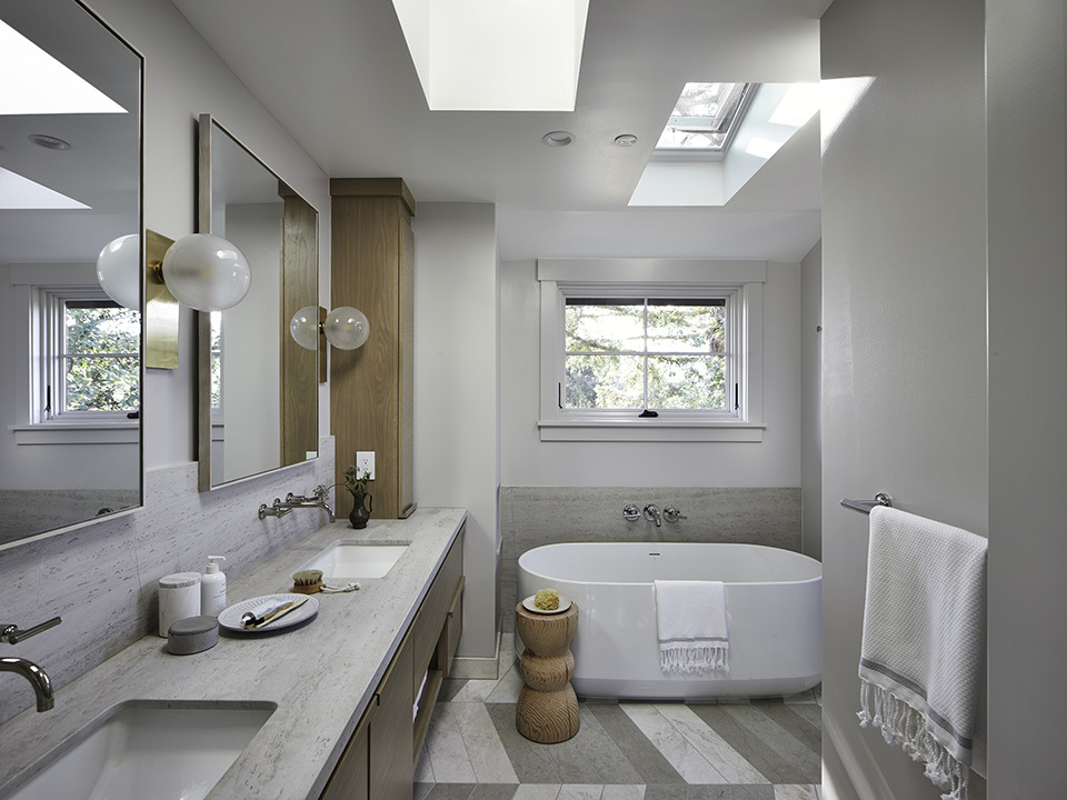 Neutral color bathroom with two skylights