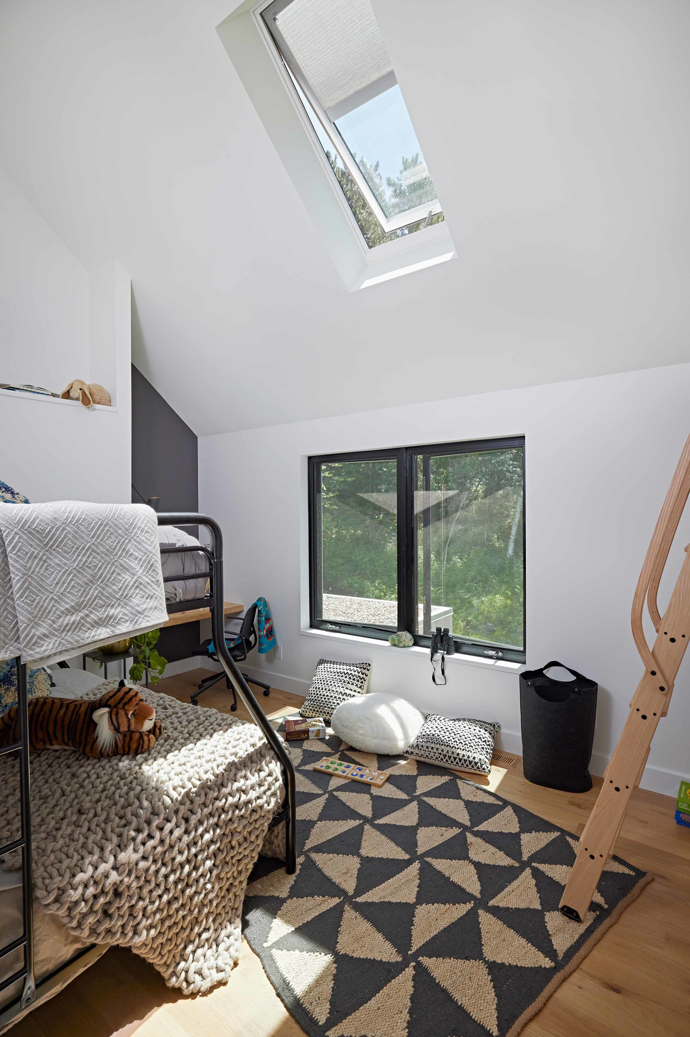 Bedroom with skylight over a bunk bed