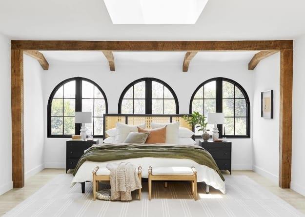 Bedroom skylight cream green rust linens