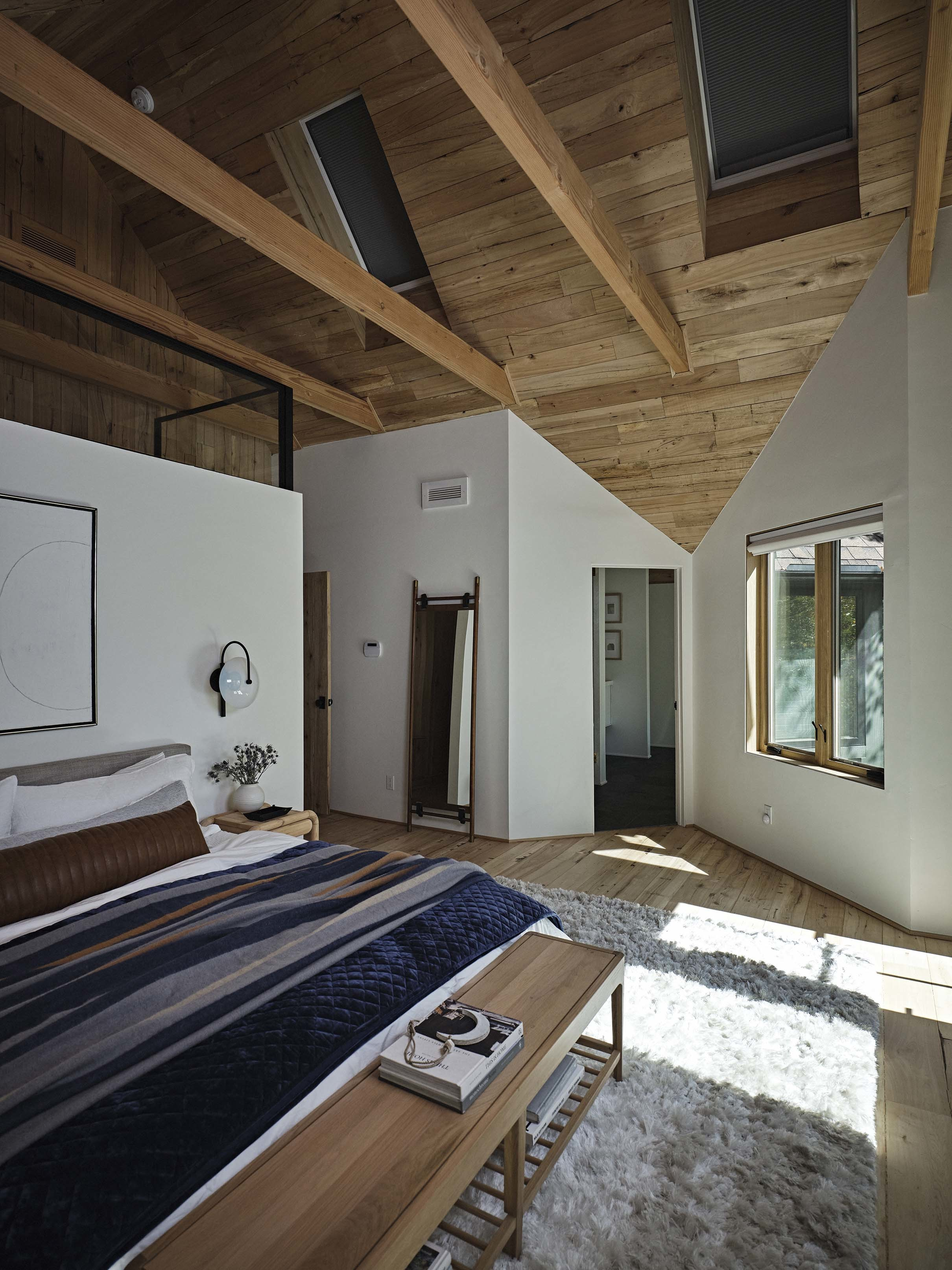 Bedroom with skylights shades closed
