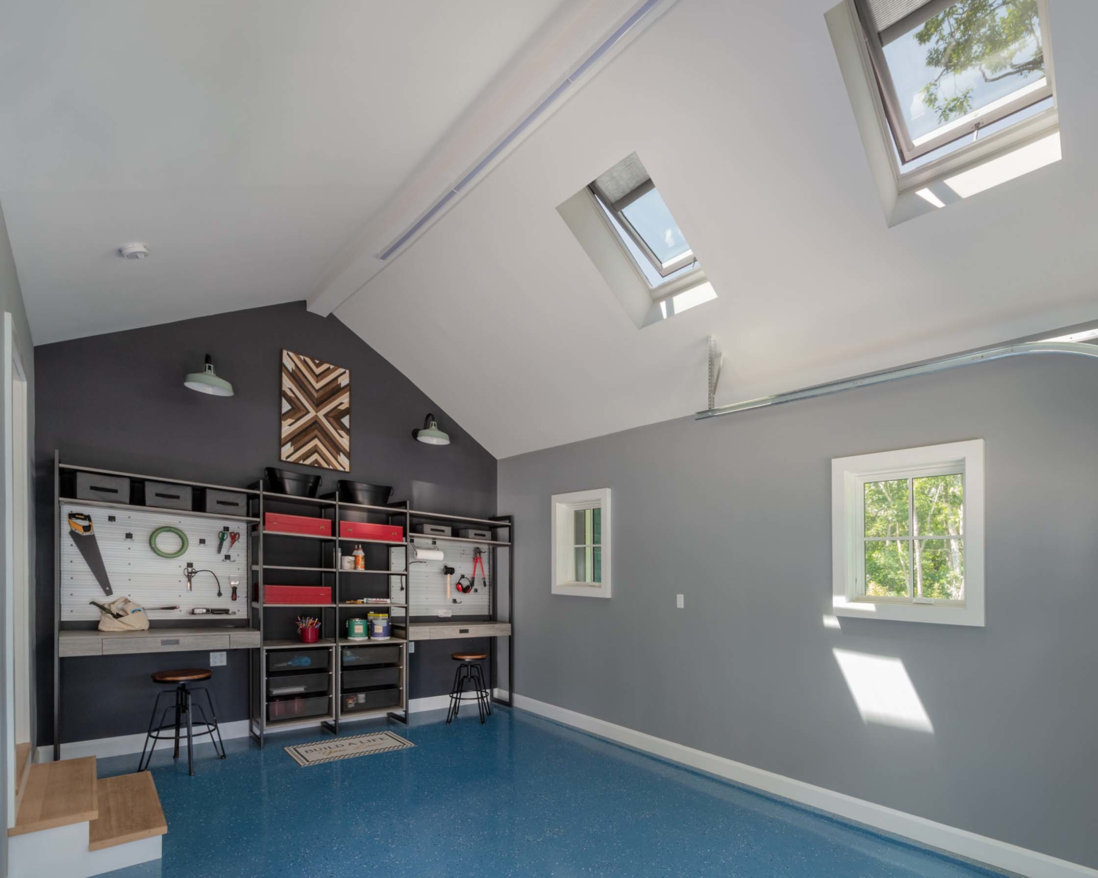 grey and blue garage or maker space with two skylights