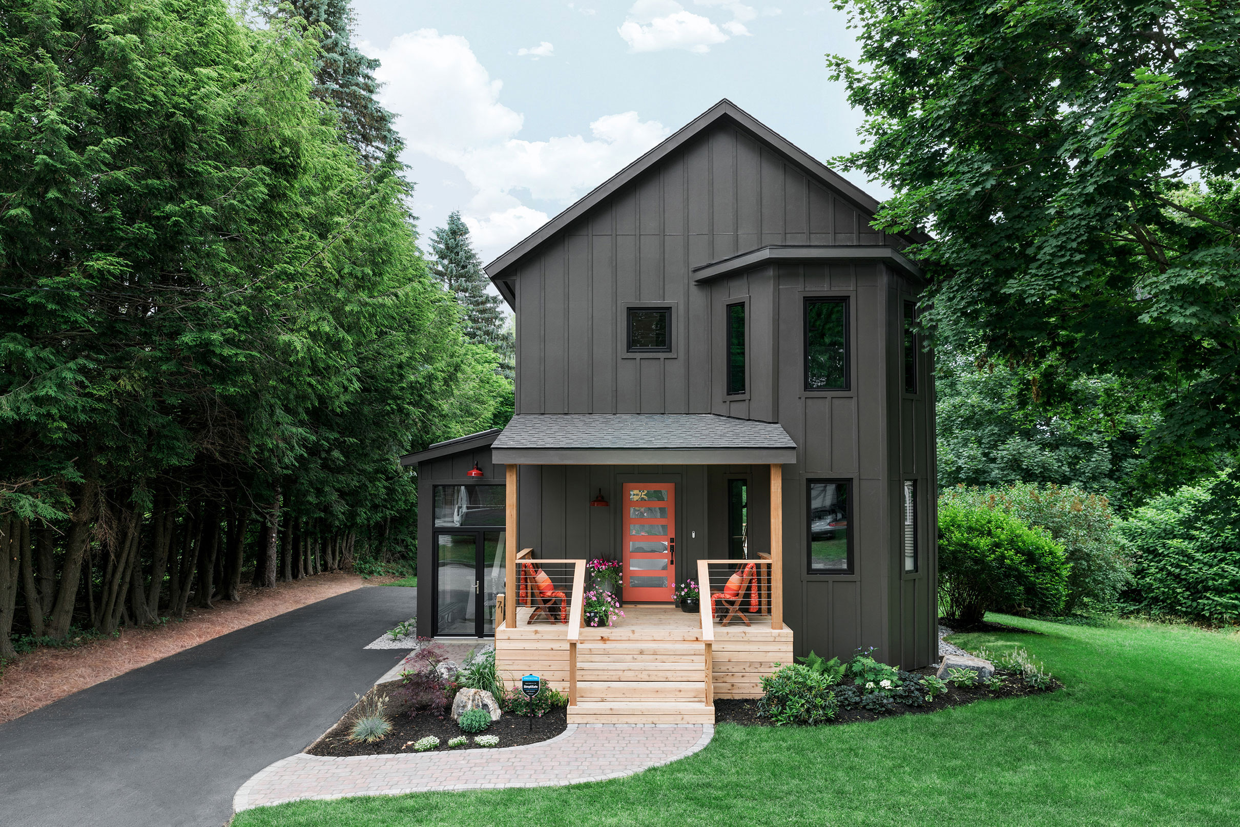 Grey house with colorful front porch small