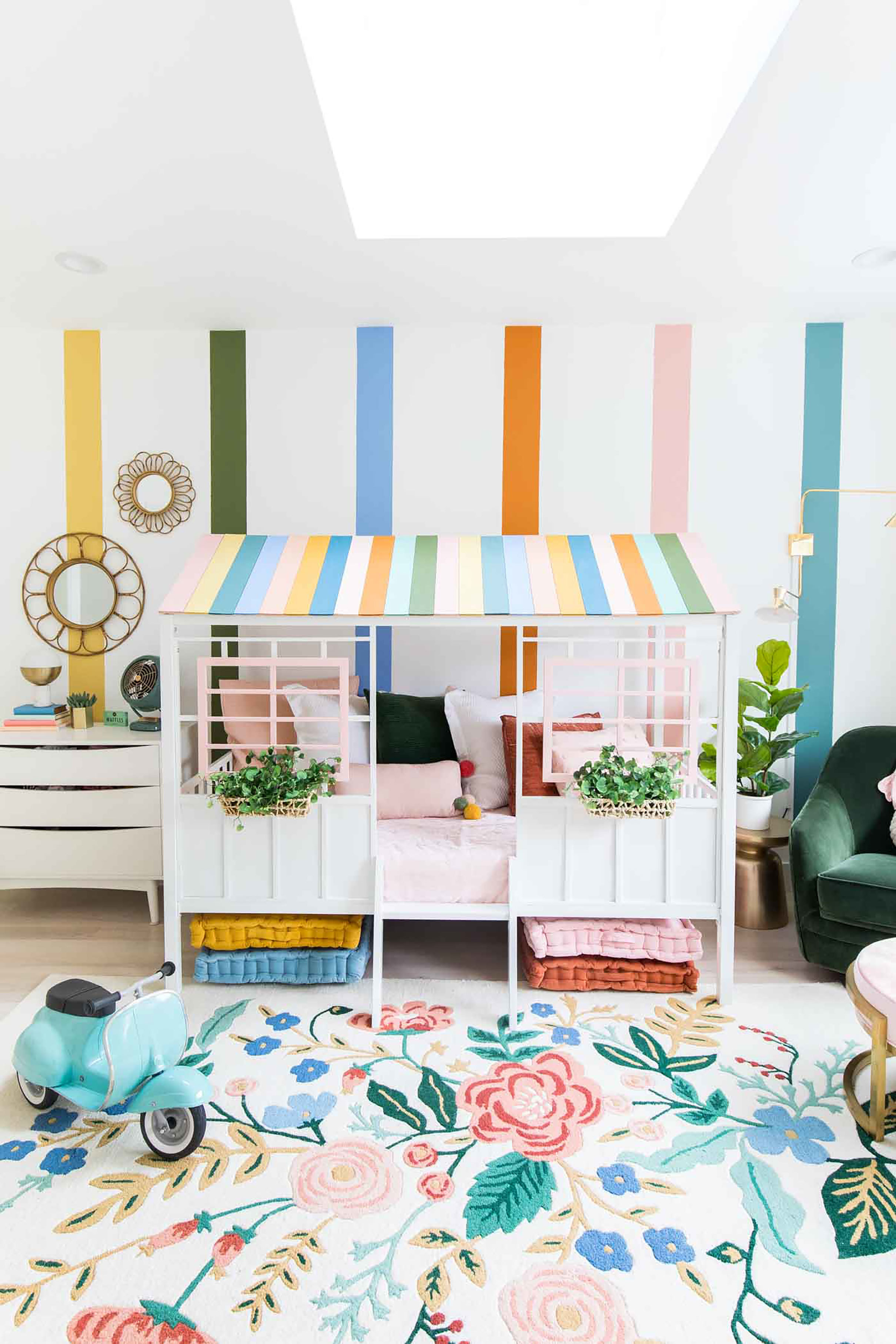 Pastel colored children's room with a skylight and playhouse bed
