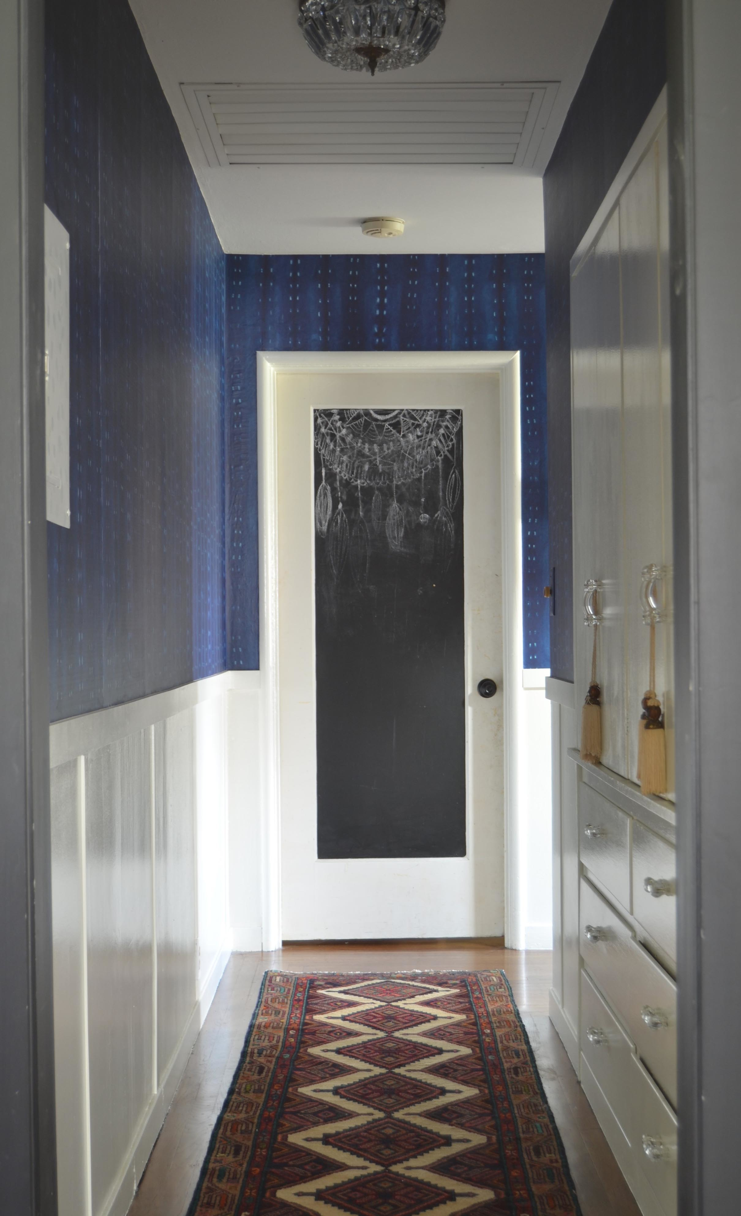 Hallway rug blue wallpaper dark