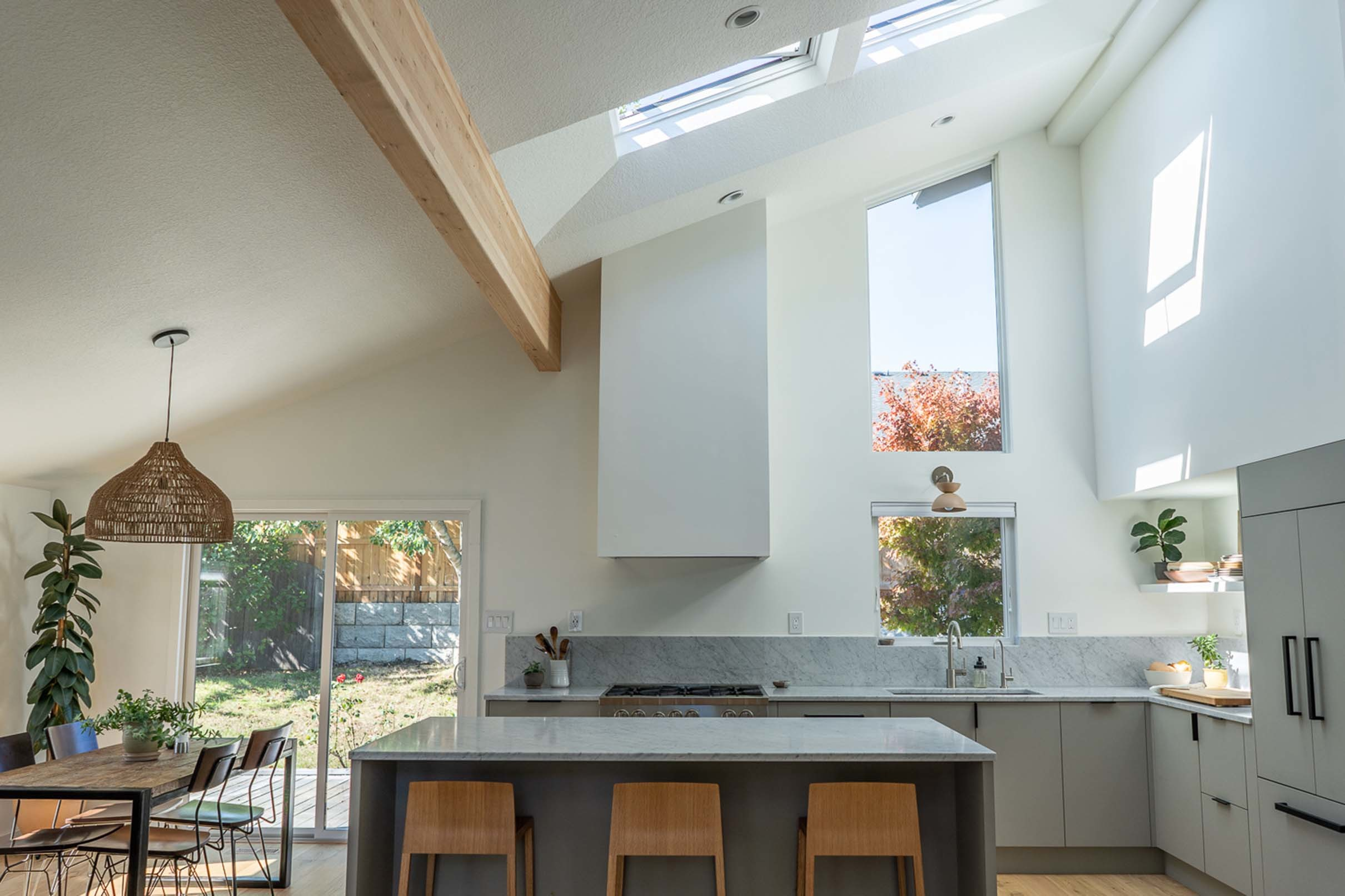grey white and natural wood kitchen with two skylights