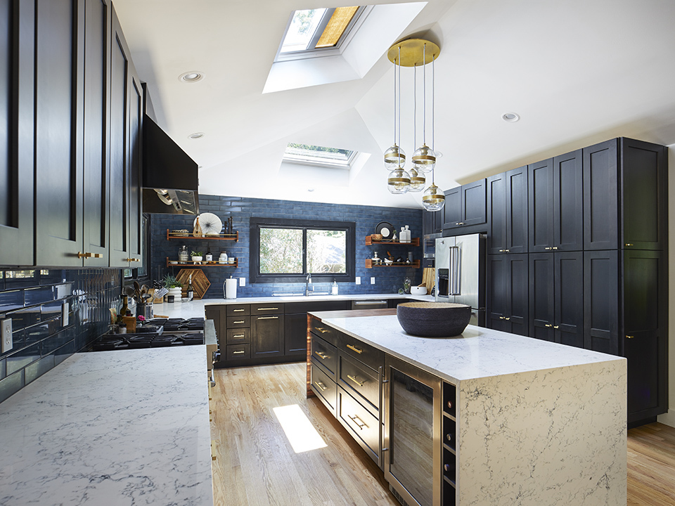 blue and black kitchen with two skylights