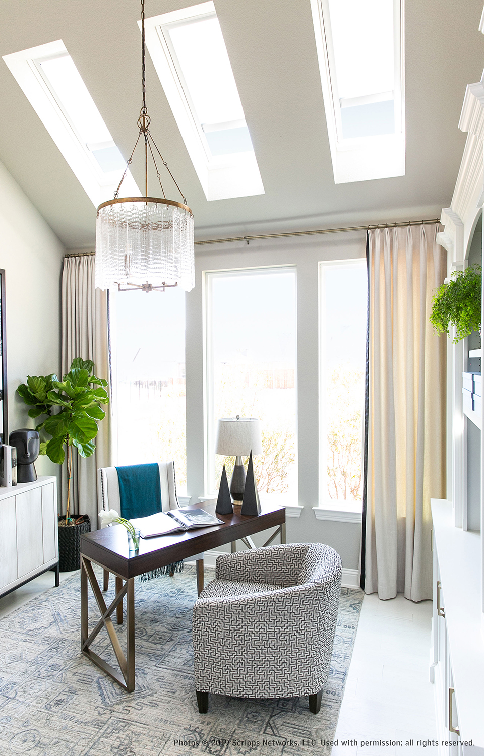 White light filled home office with skylights, windows and ceiling to floor draperies