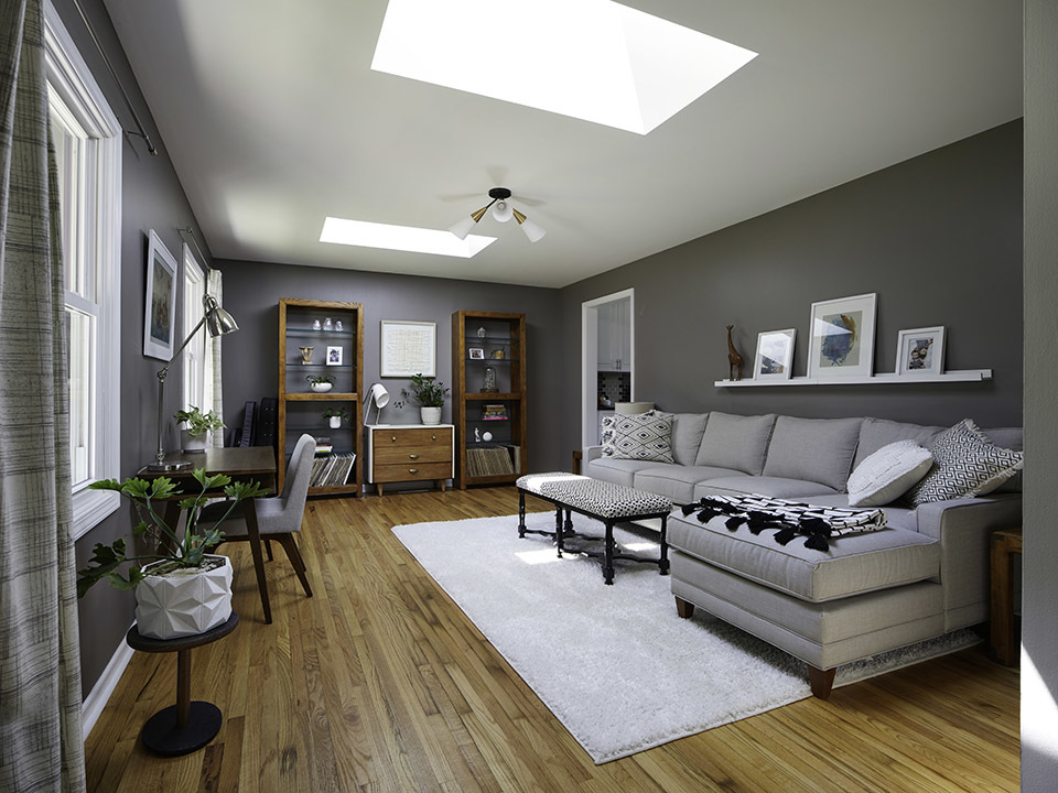 Skylights bring natural light into this dark gray living room.