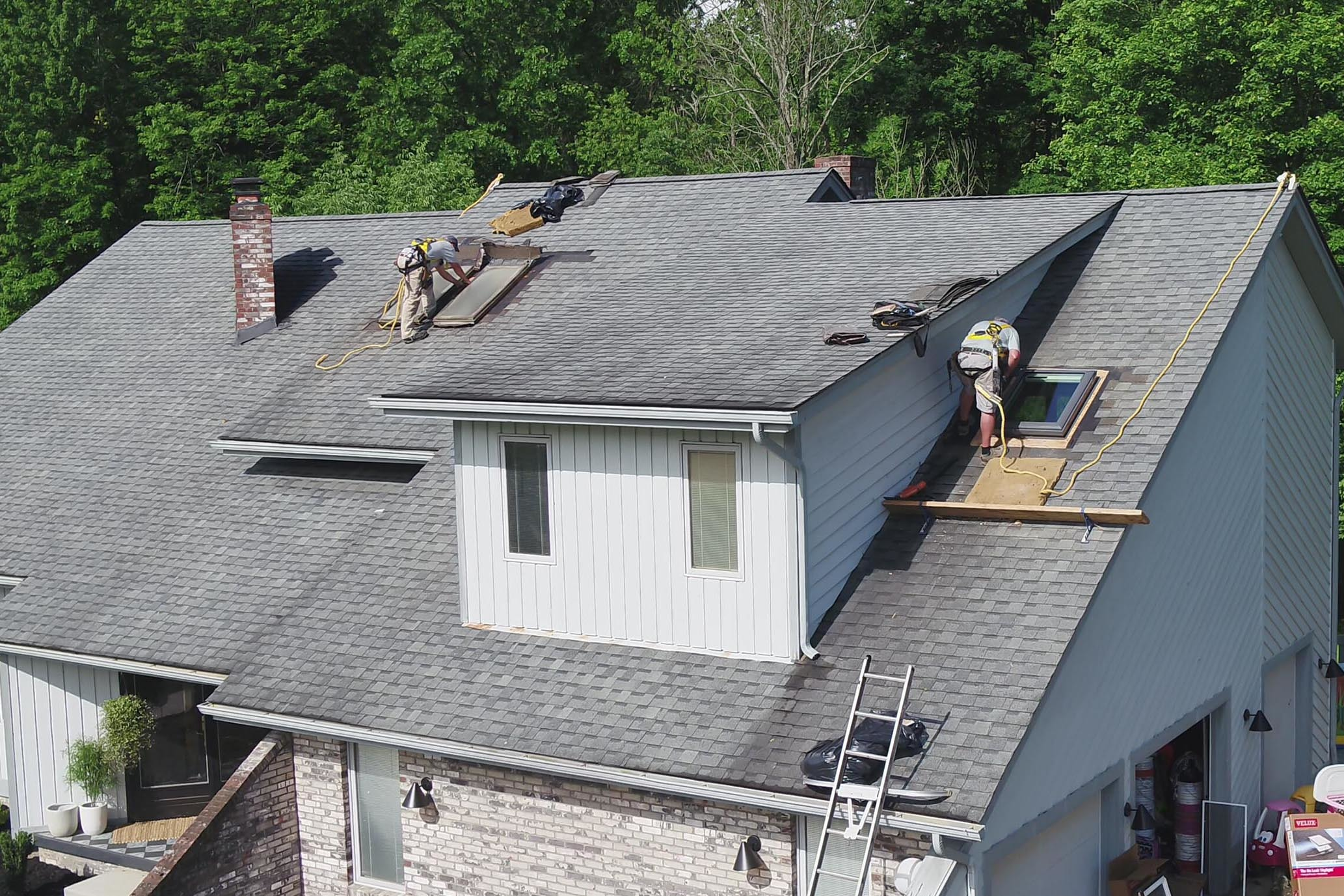 Skylight installers working on a roof small
