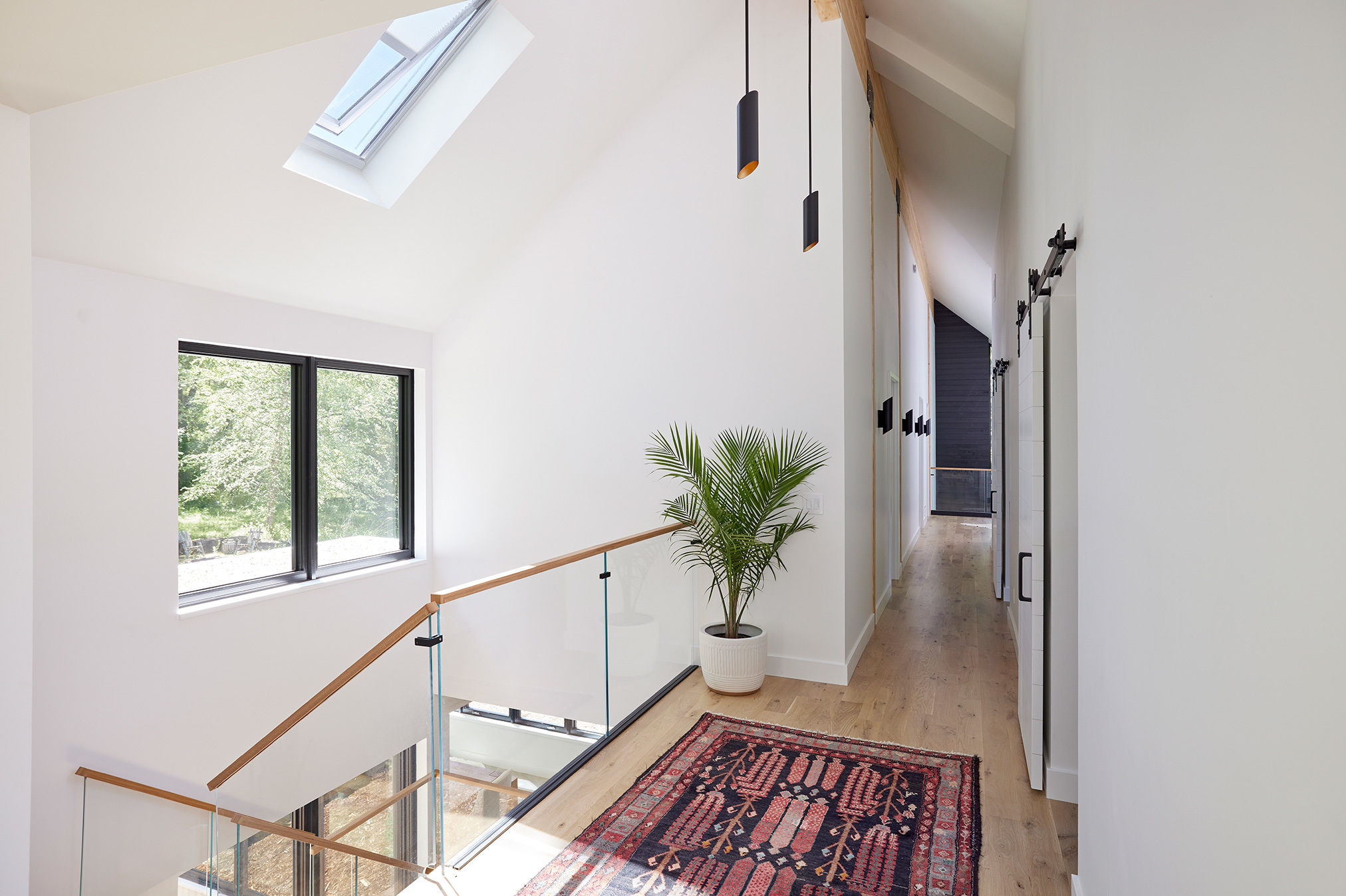 A minimalist stairwell brightened by a skylight
