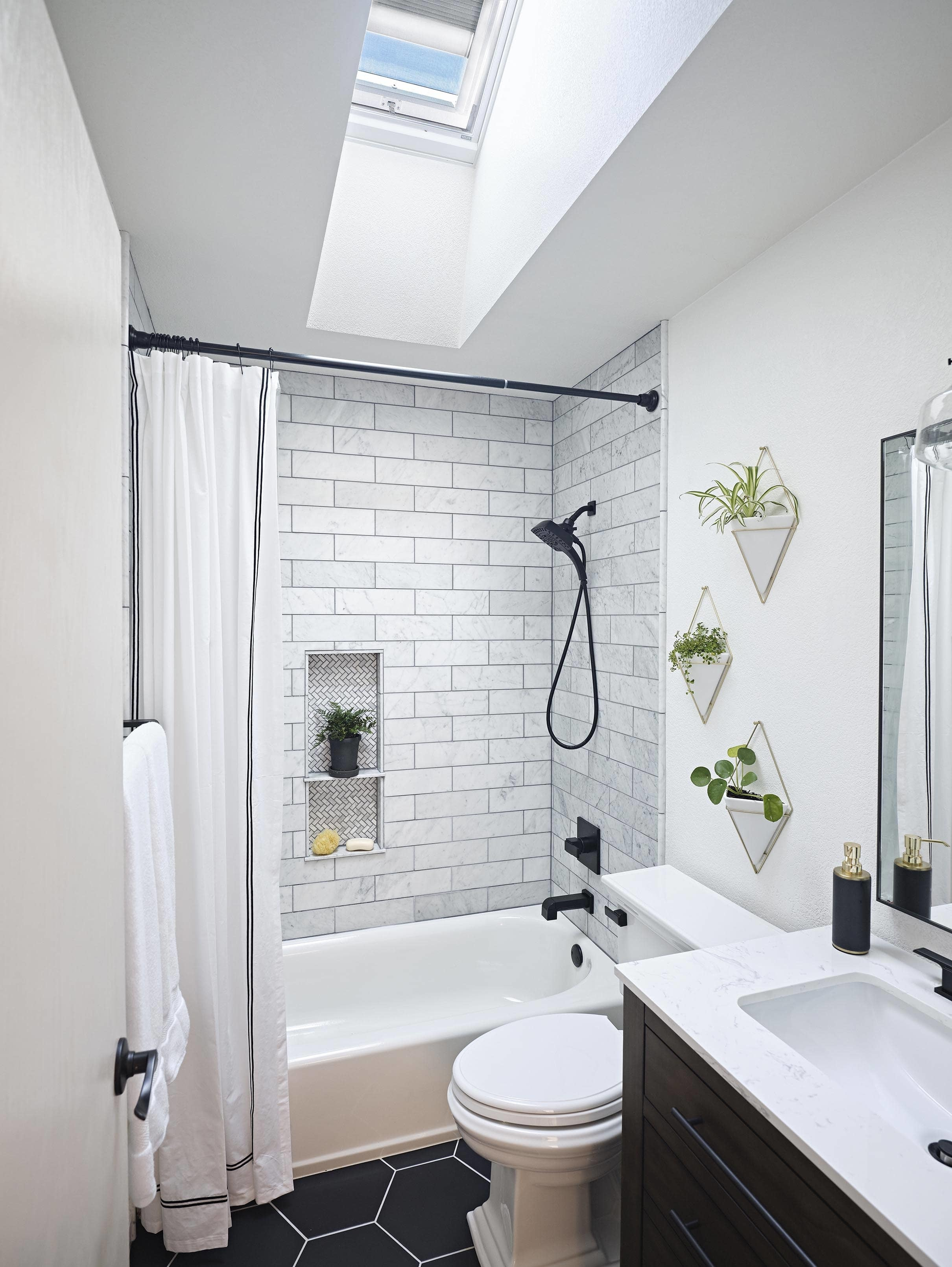 Small bathroom skylight black tile