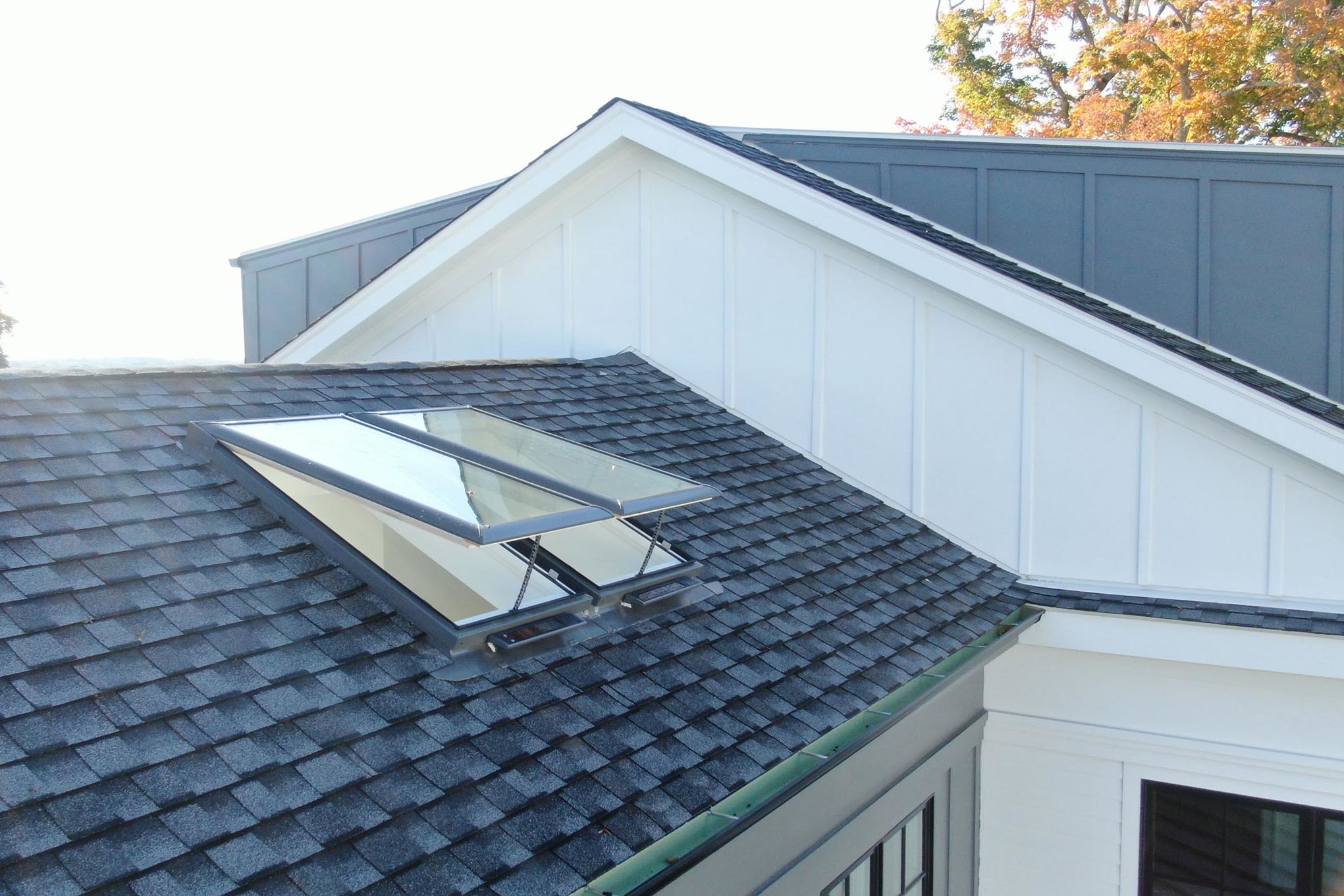 Two Open Skylights On A Rooftmb