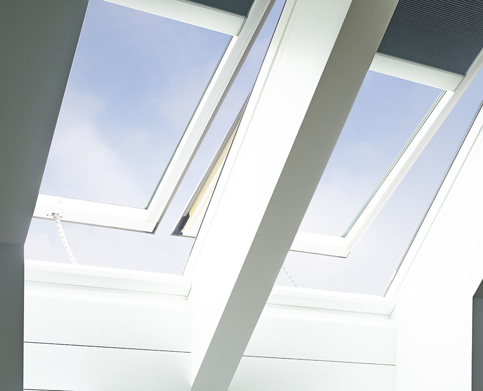 Two VELUX skylights with grey light blocking blinds