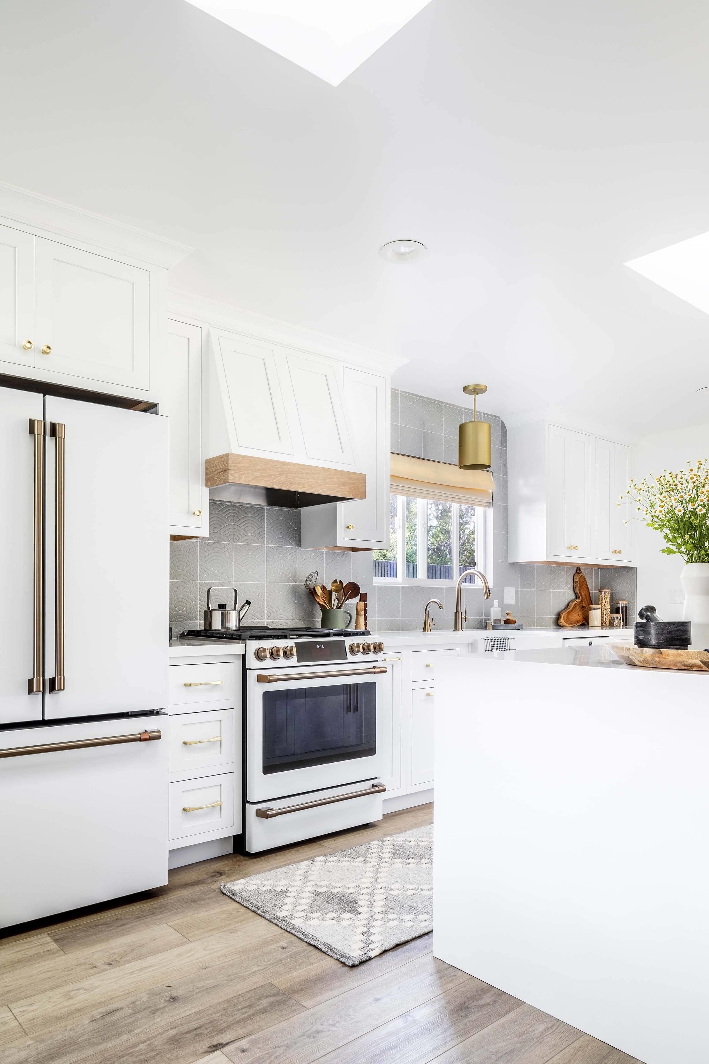 White kitchen refrigerator stove skylights