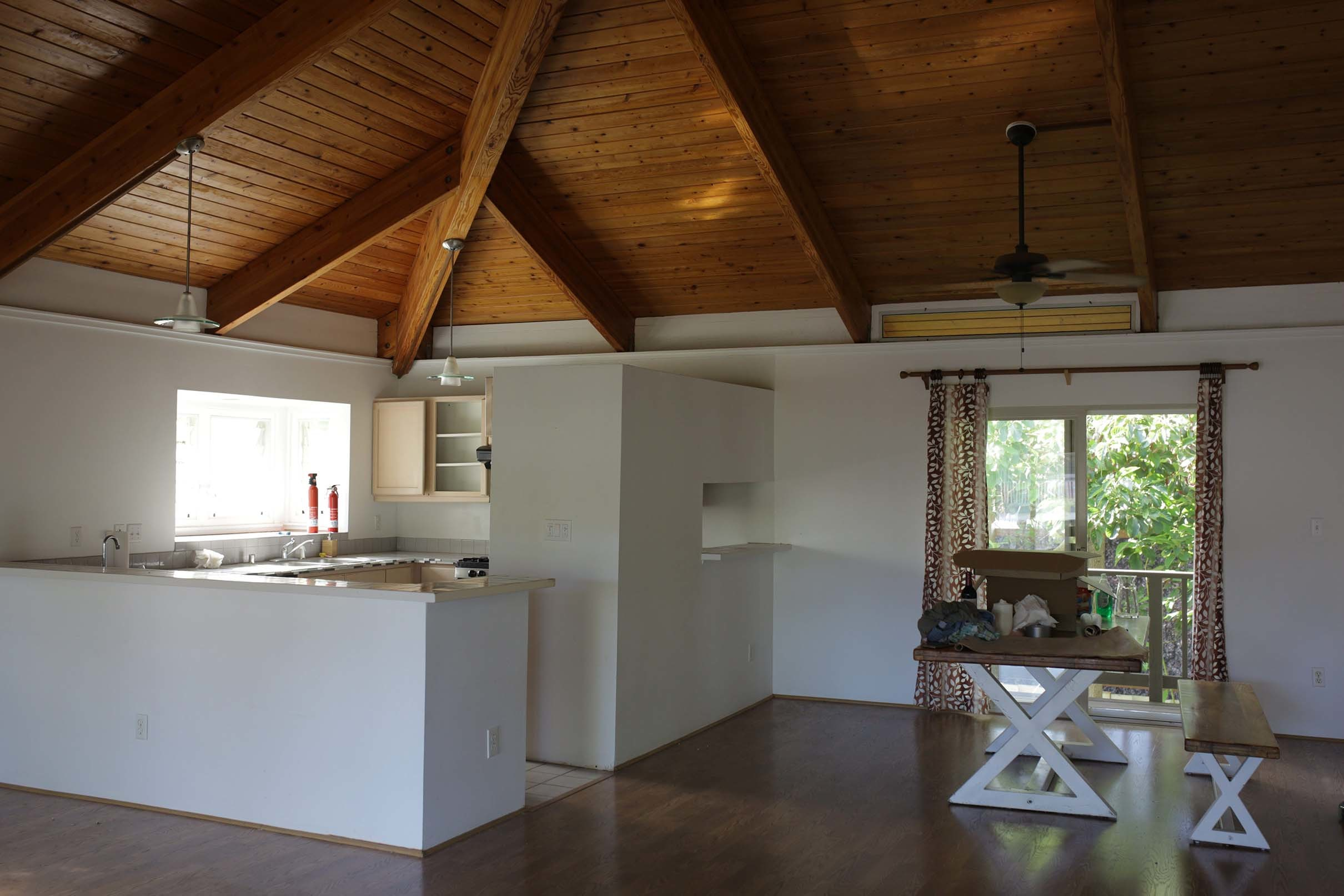 White kitchen wood ceiling dark