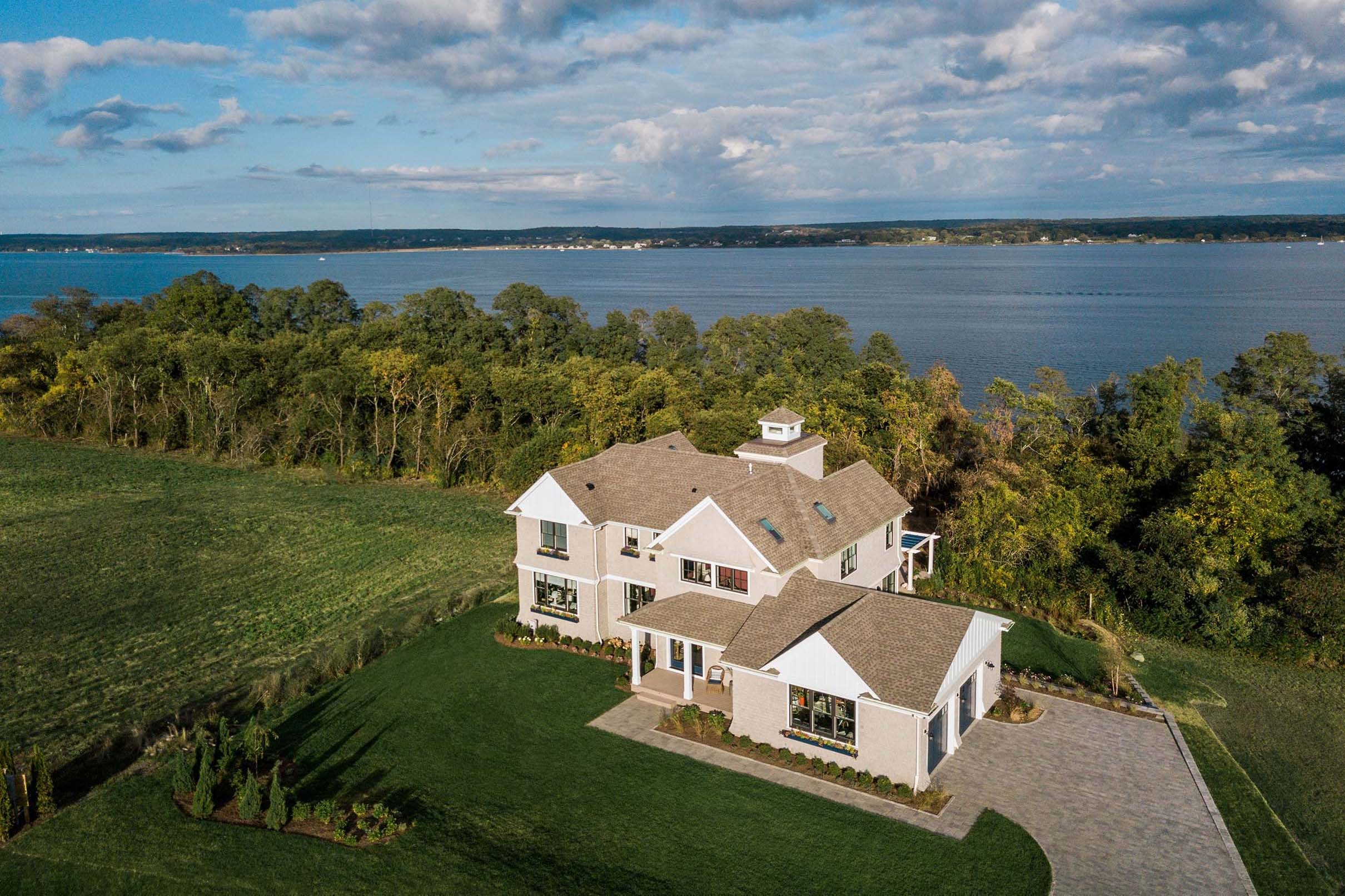 Aerial view of waterfront home small
