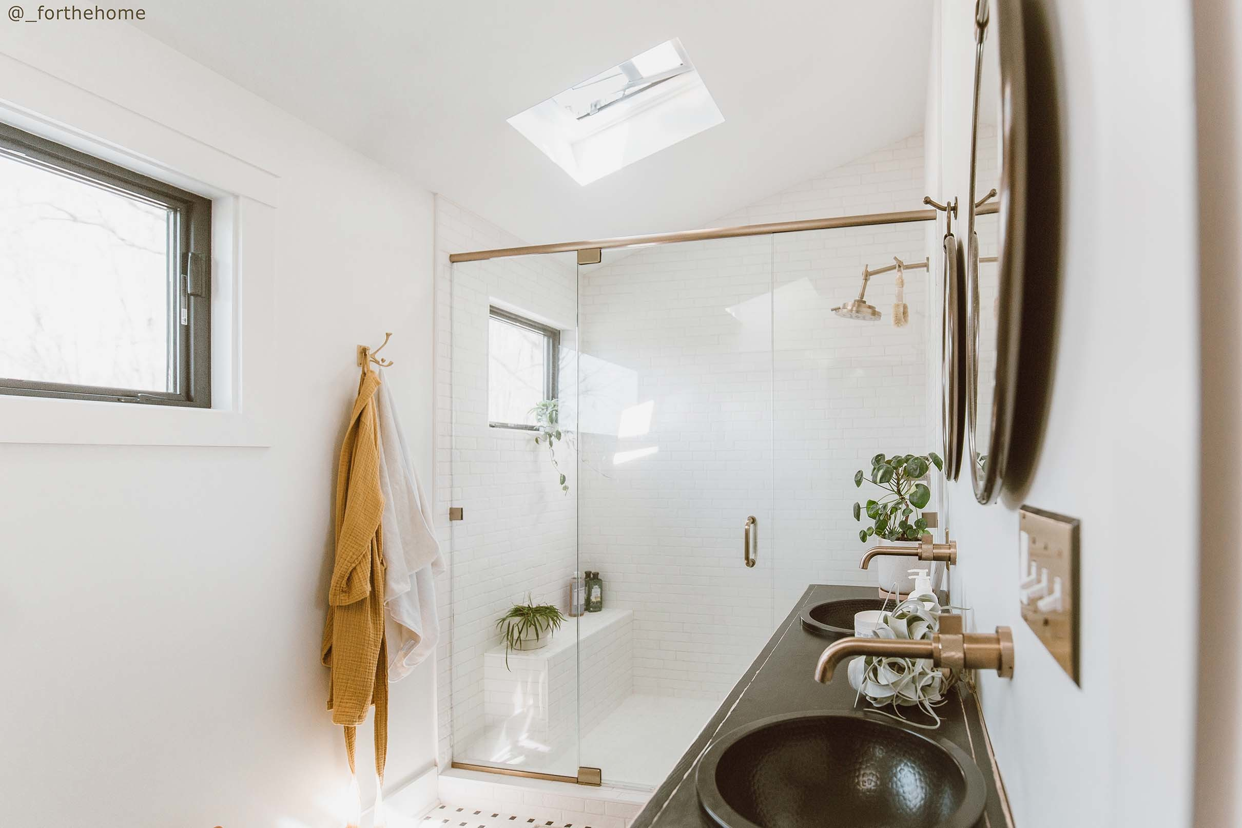 Bathroom white skylight shower black vanity