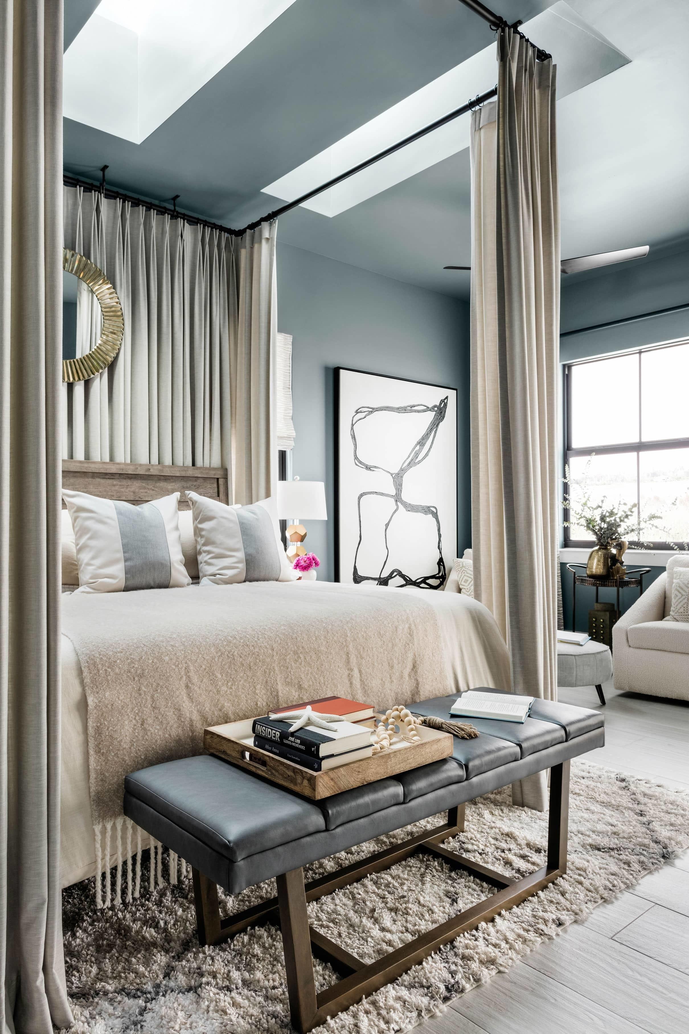 Bedroom blue taupe skylights framed bed