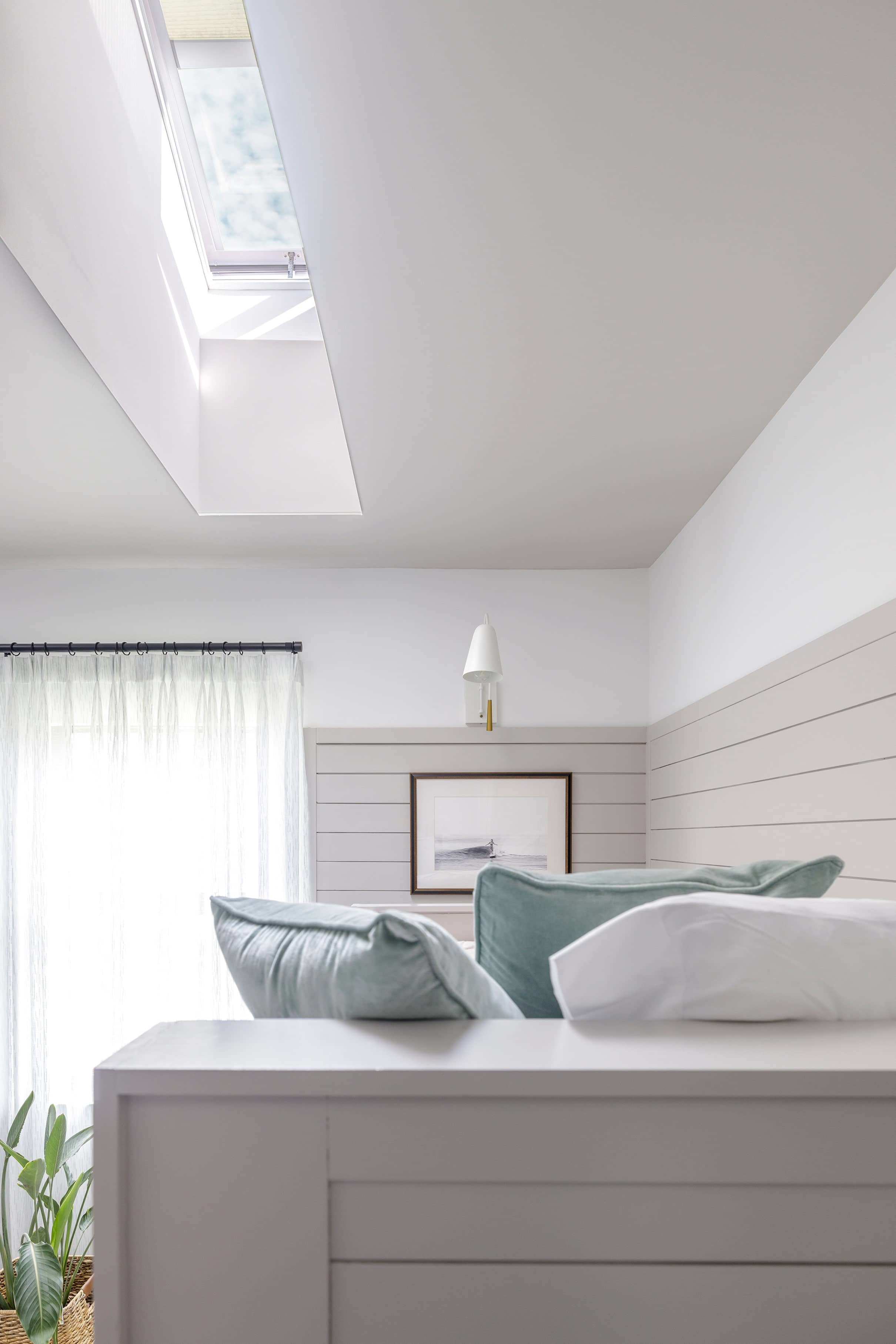 Bedroom bunk bed skylight grey white pillows