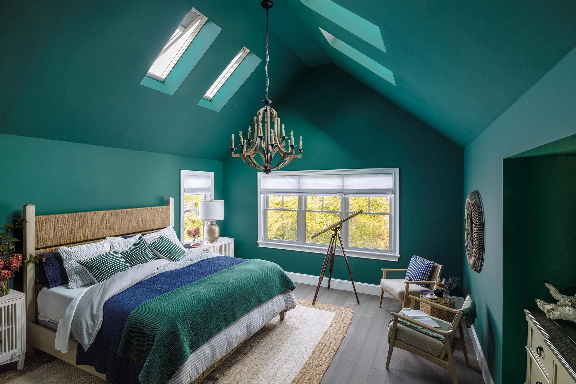 Bedroom painted dark green with four skylights