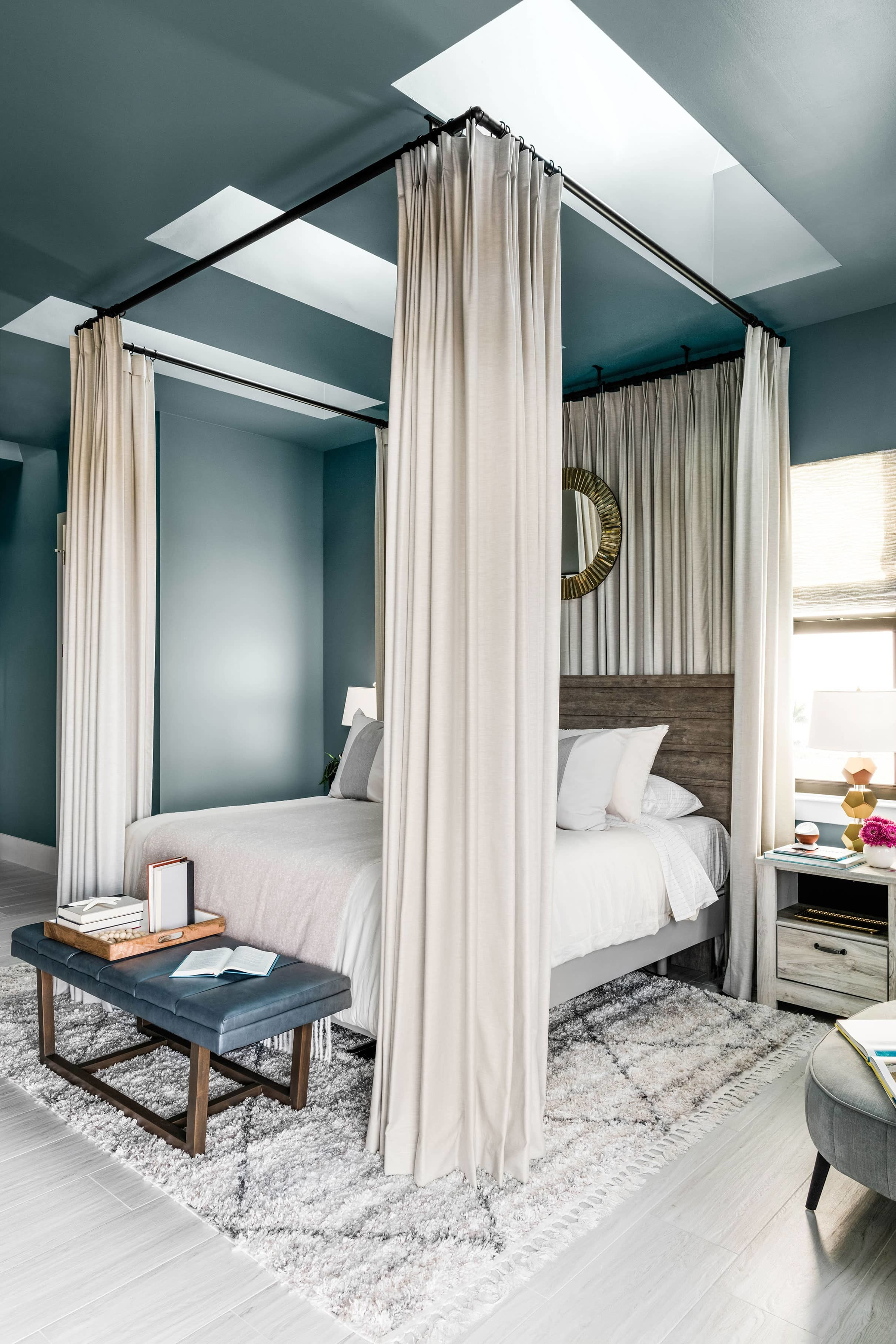 Bedroom skylights blue walls taupe draped bed