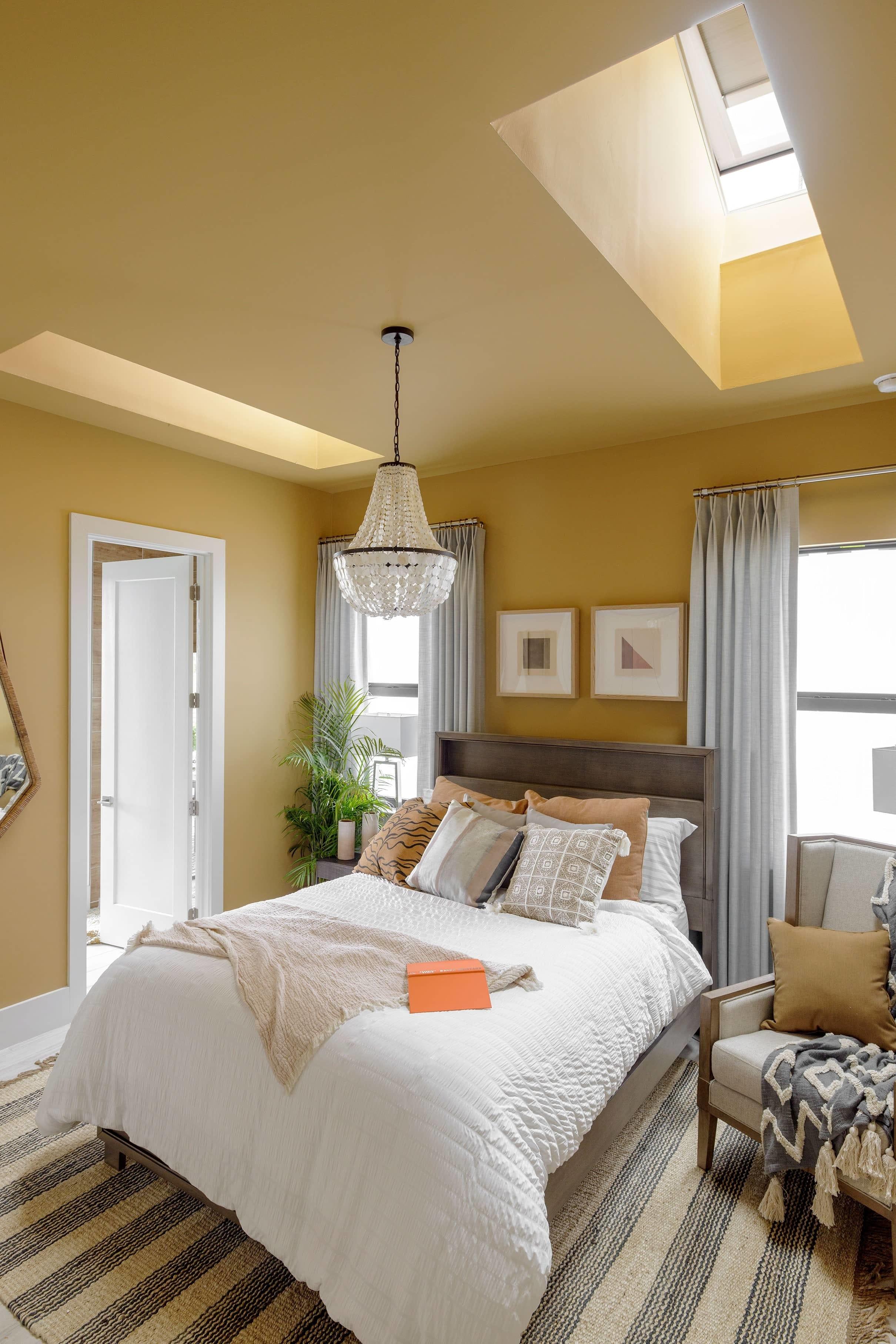 Bedroom skylights shades yellow walls