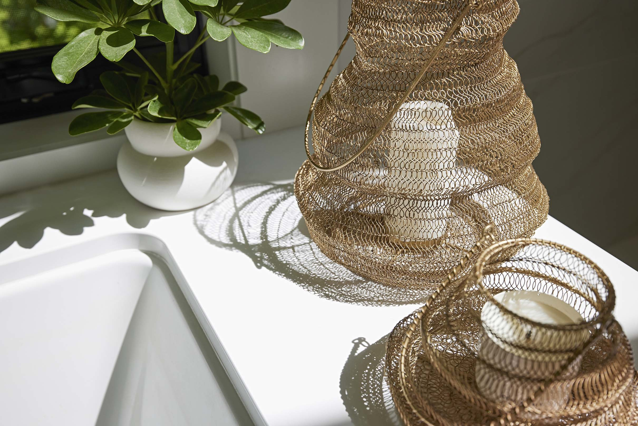 Brass candle baskets sunlight plant
