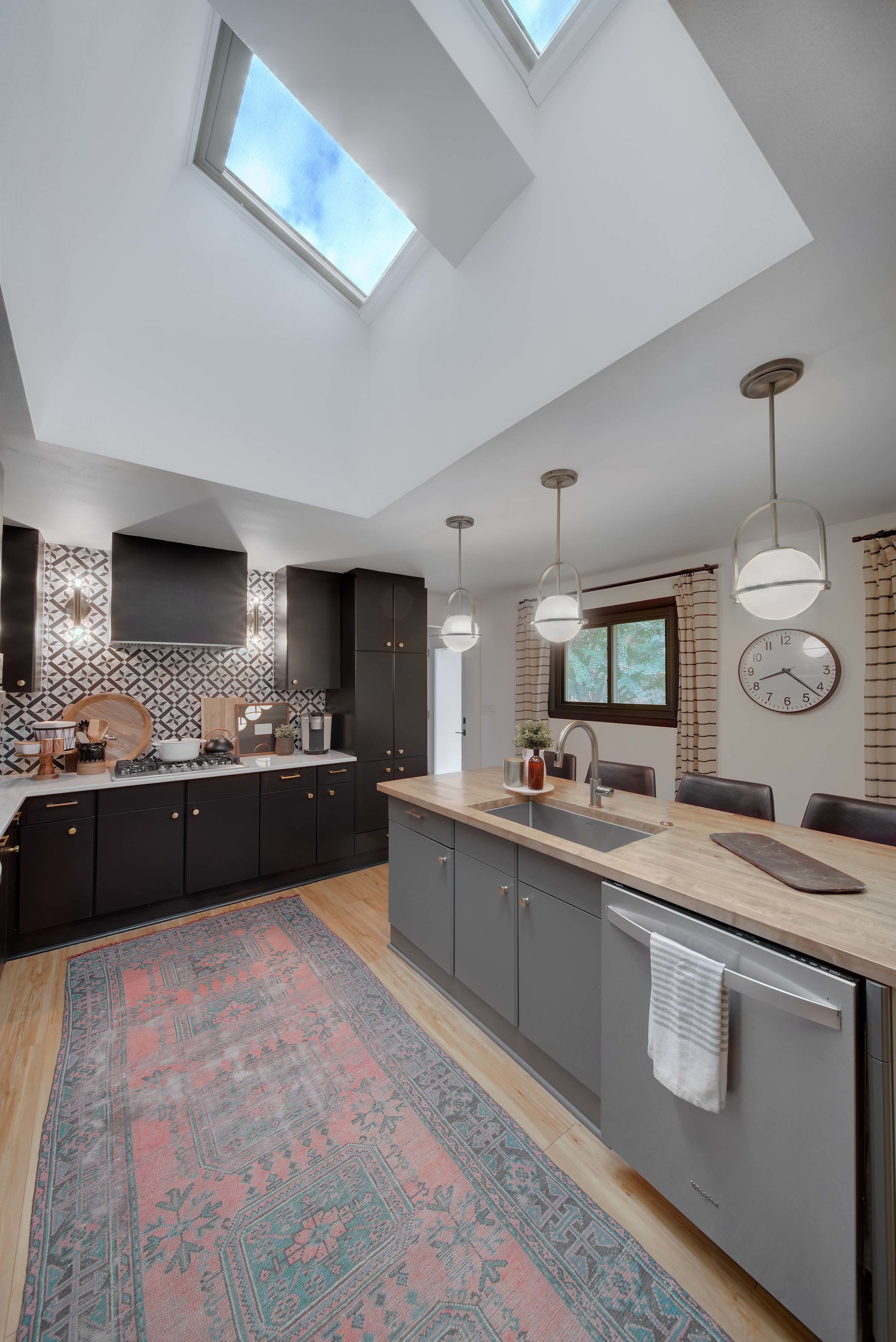 Kitchen antique rug skylights black cabinets