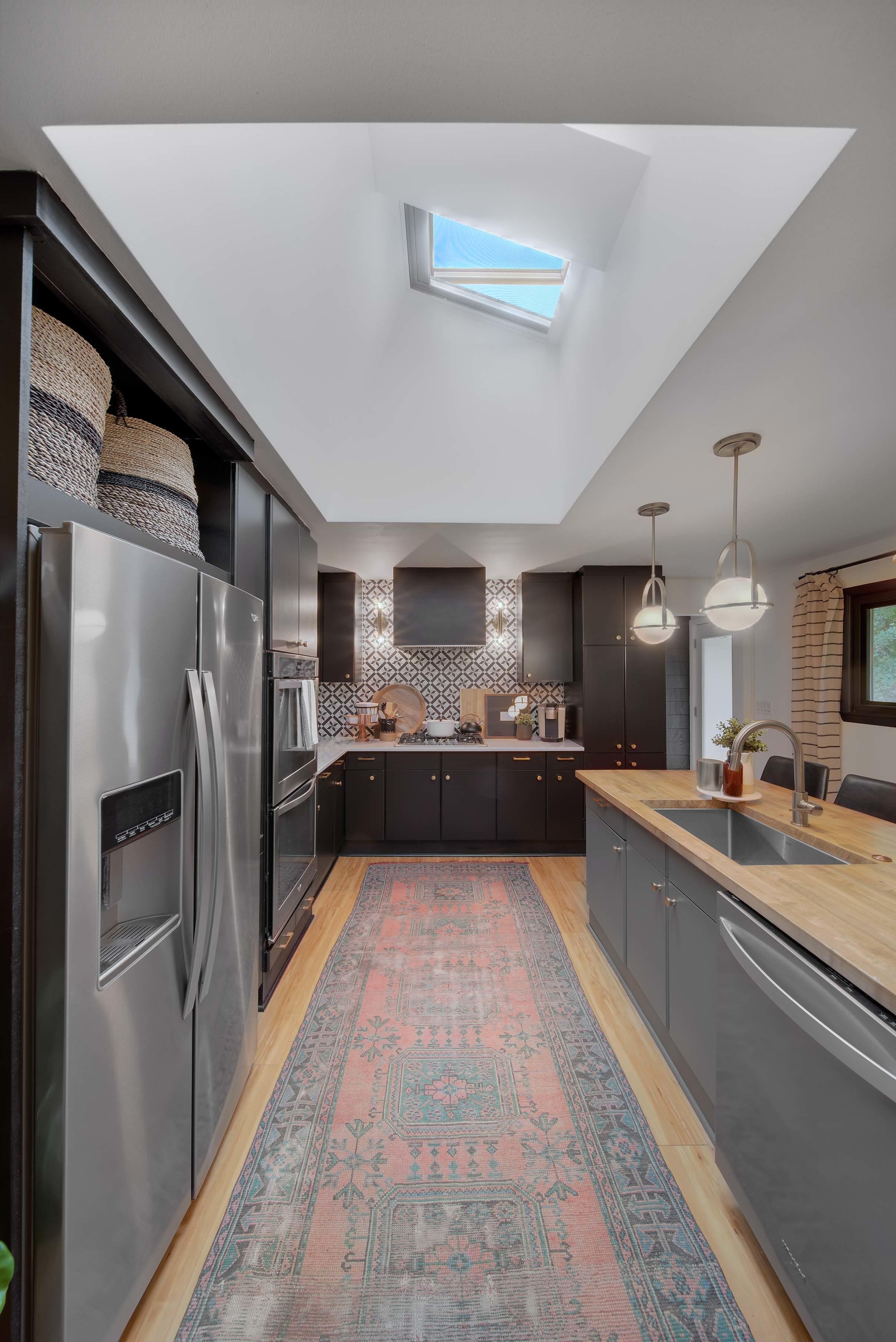 Kitchen open skylights vintage rug butcher block island