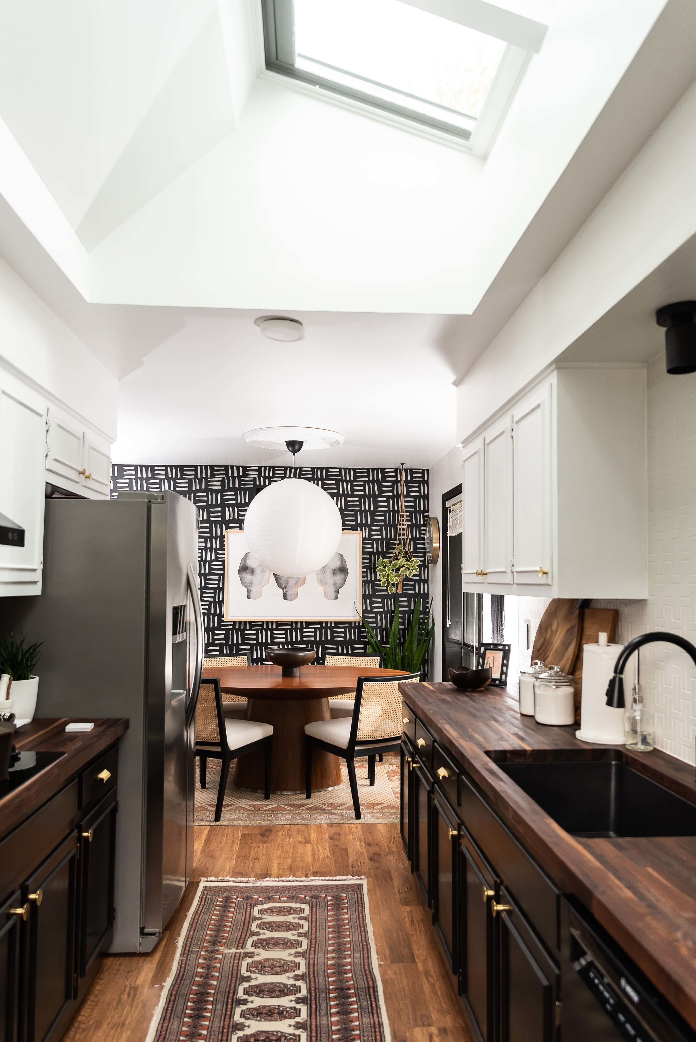 Kitchen skylights black and white cabinets
