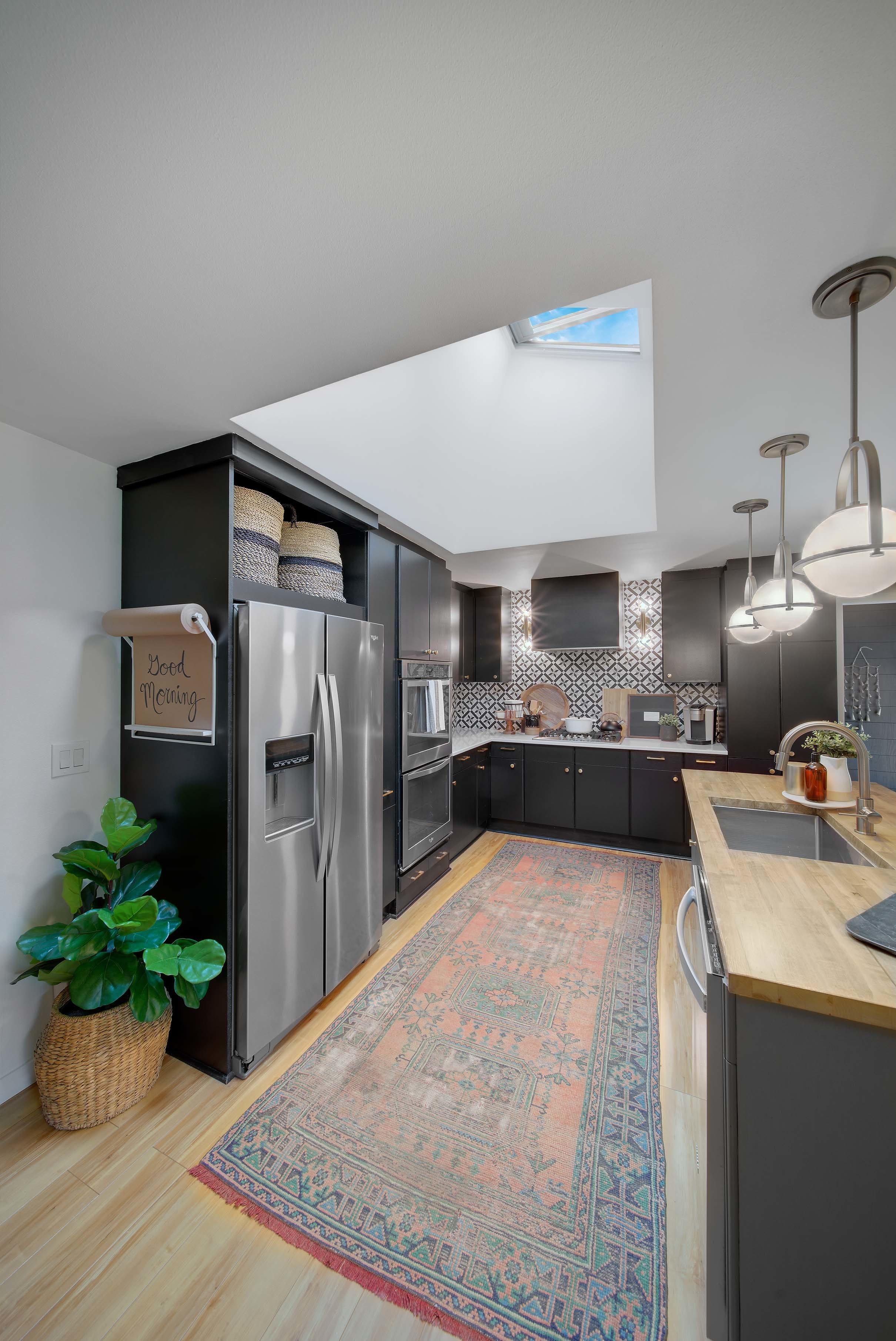 Kitchen skylights vintage rug black cabinets