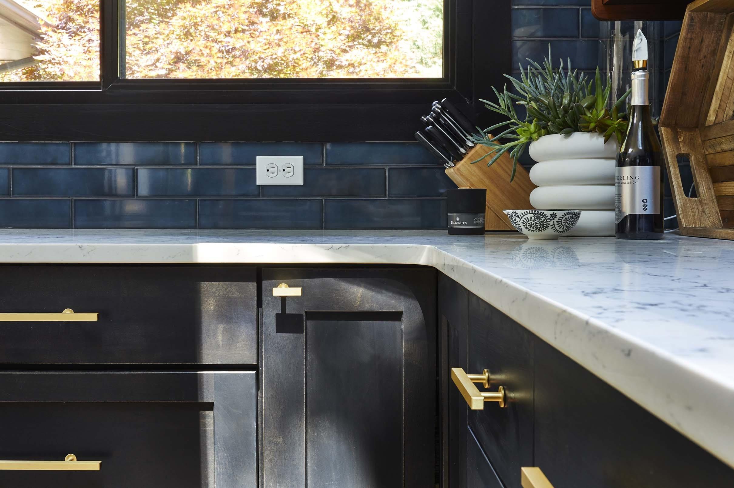 sunlight across black kitchen cabinets