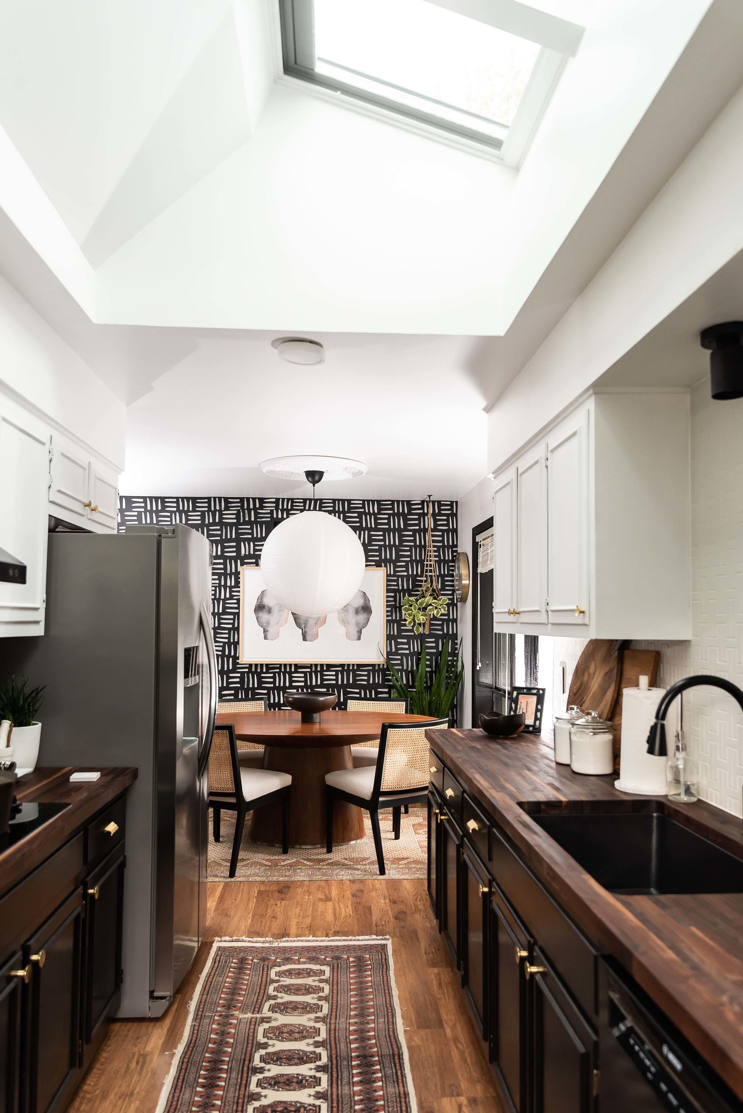 Ktichen black cabinets skylights butcher block counters