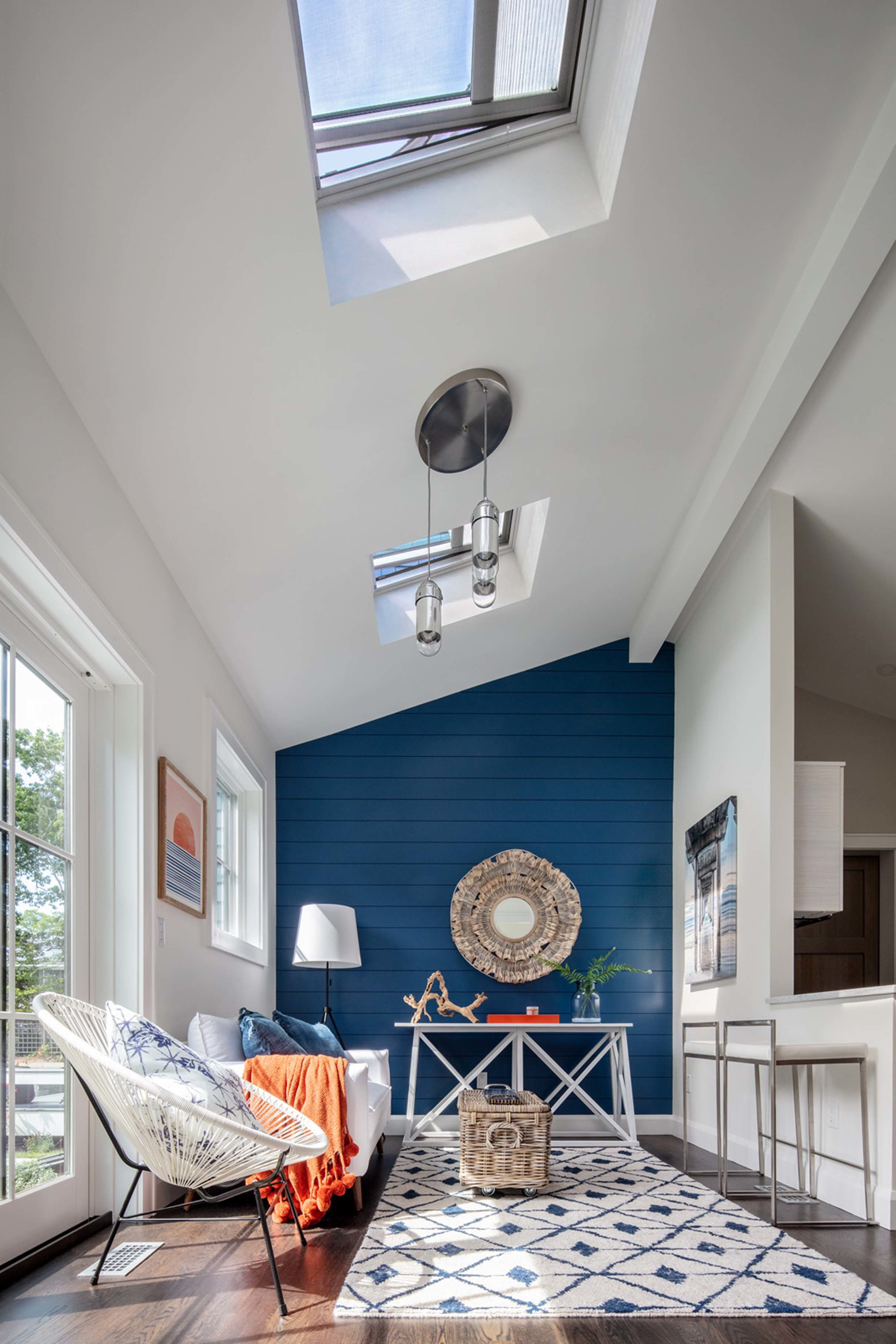 Living room skylights blue accent wall
