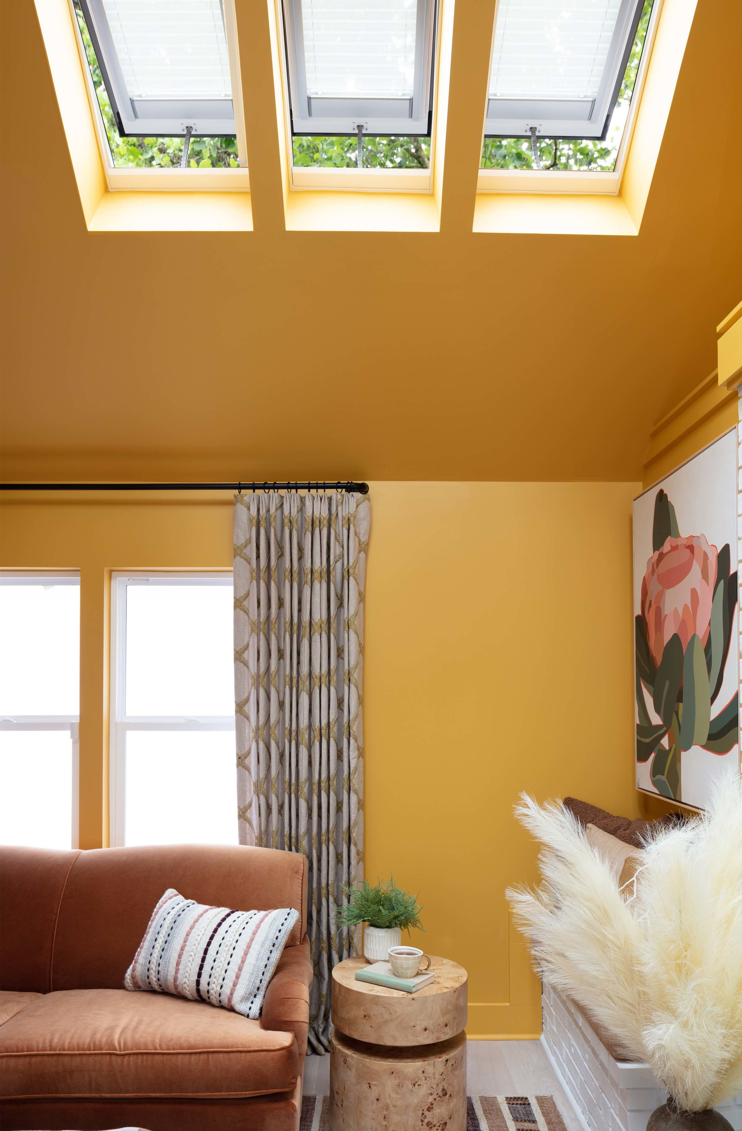 Living room skylights yellow wall ceiling