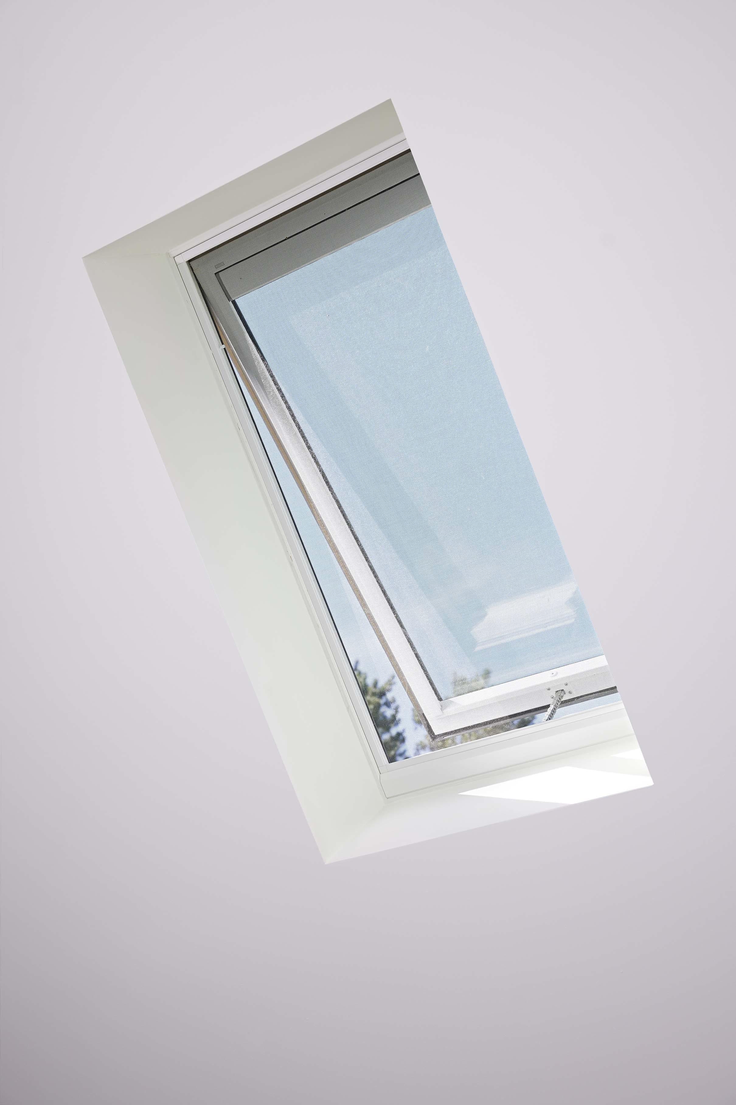 Open skylight white ceiling blue sky
