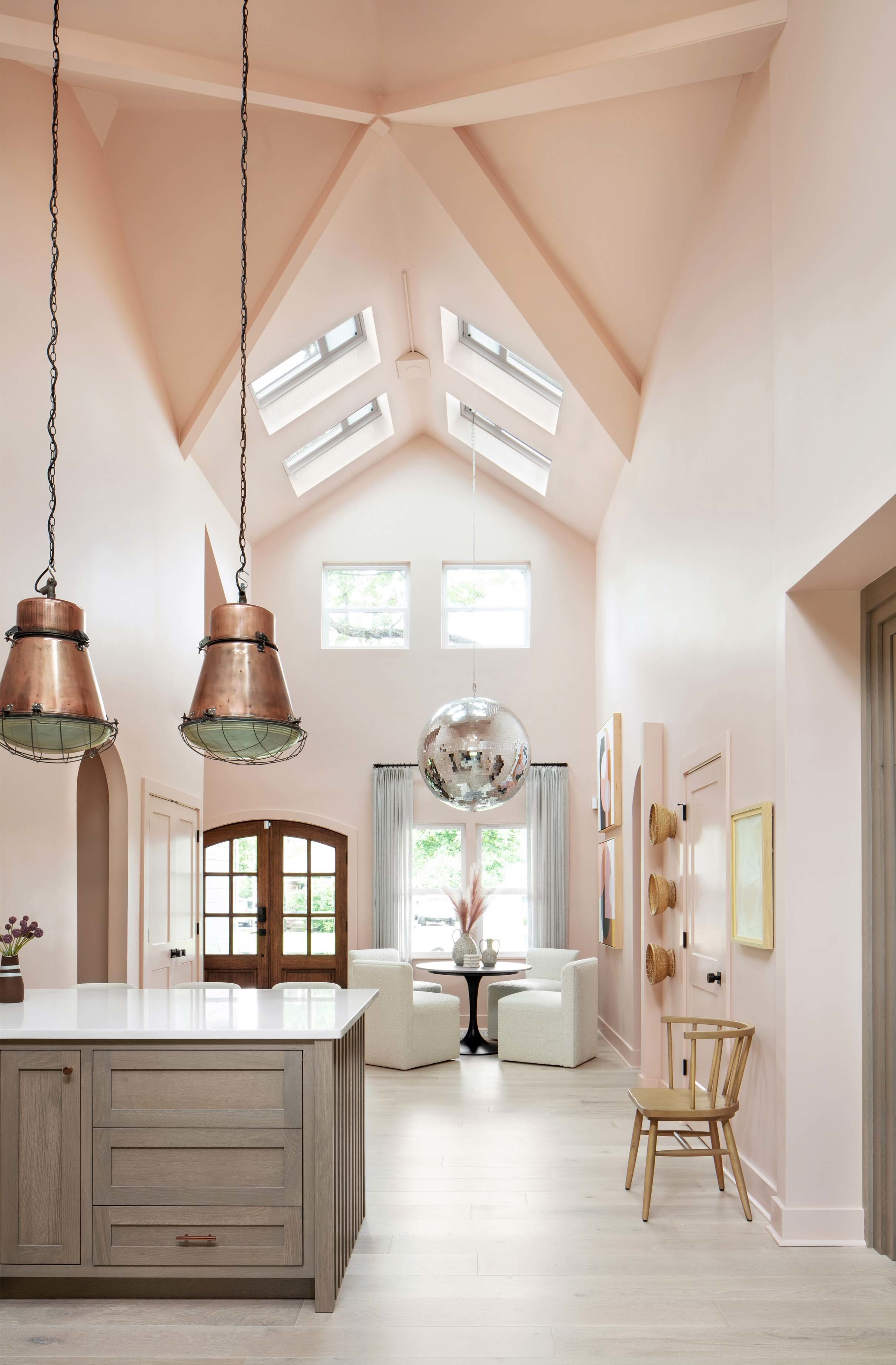 Pink dining room disco ball chanelier skylights