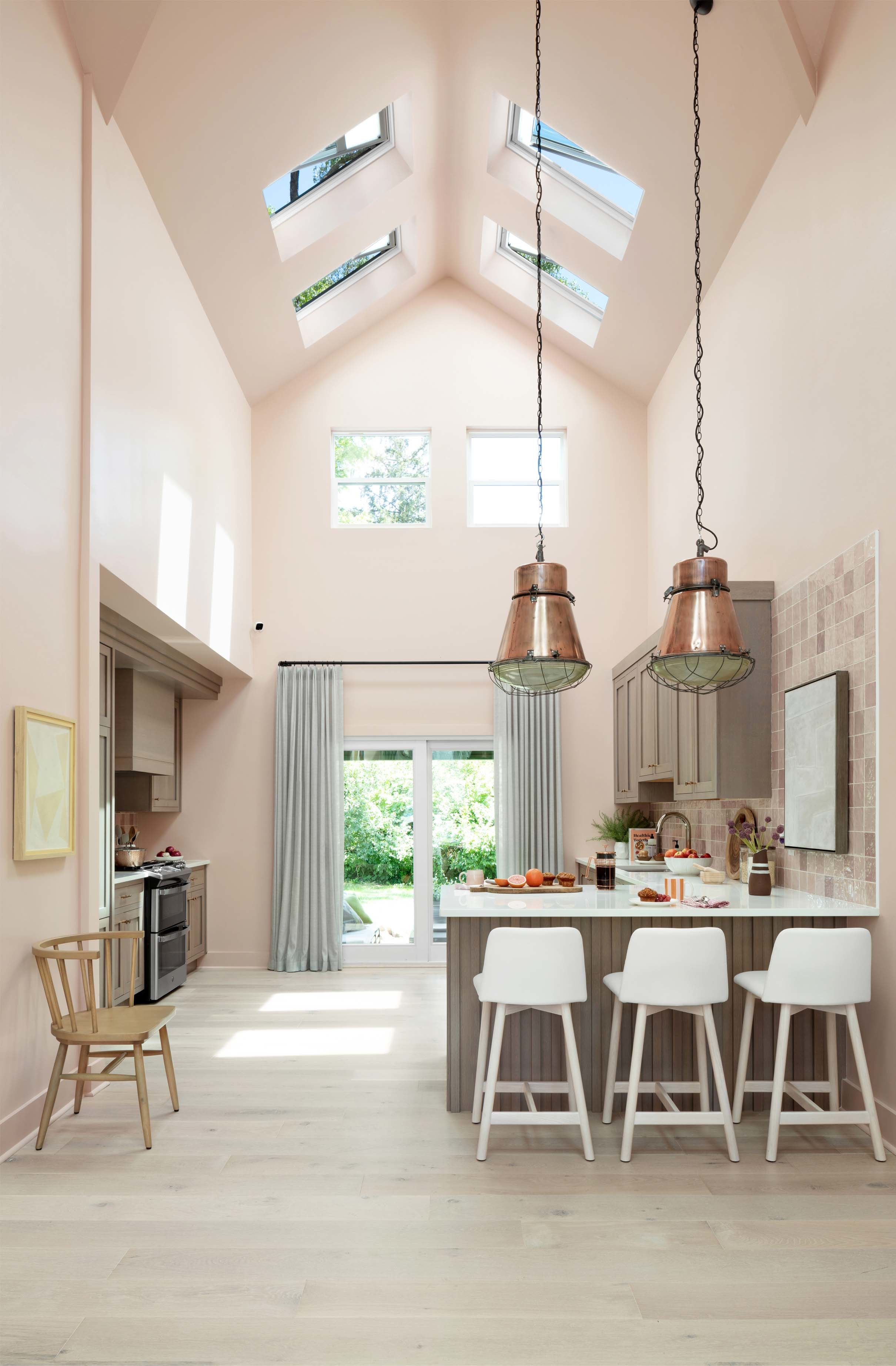 Pink kitchen skylights grey cabinets