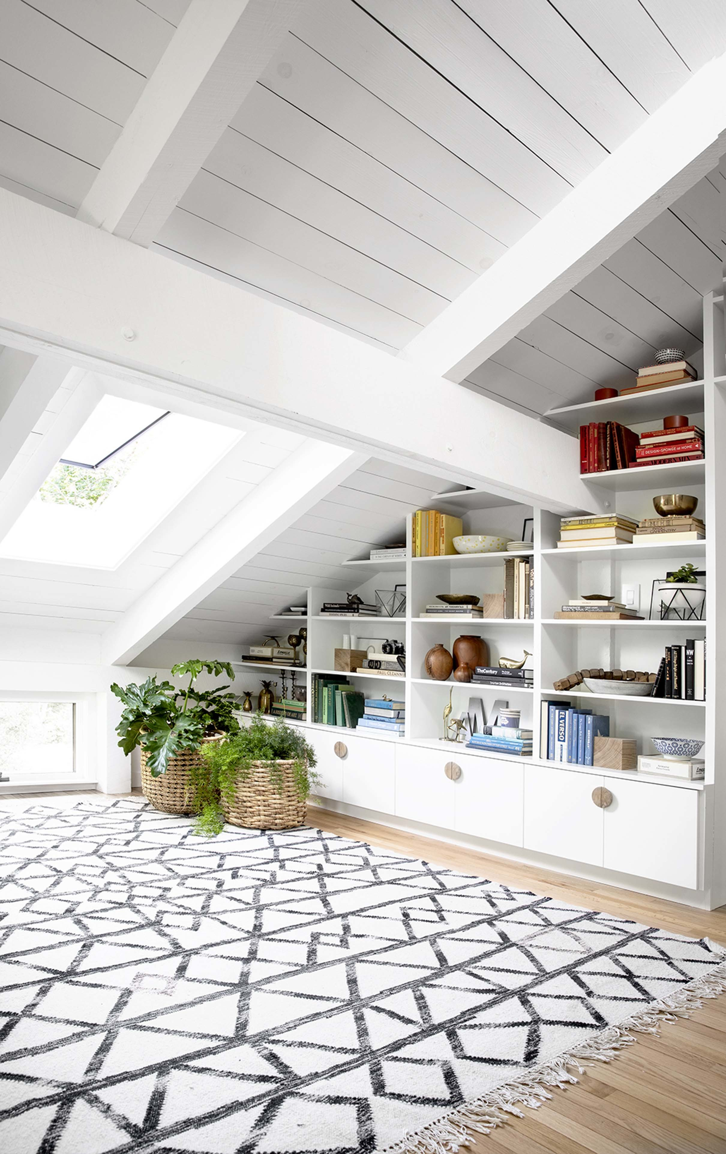 Skylight built in bookshelves white wood finish
