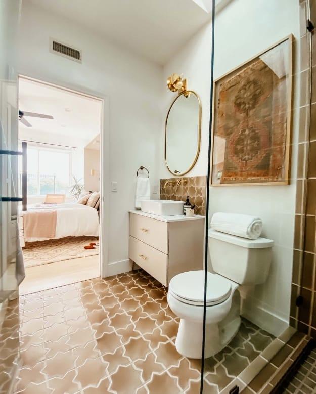 Small bathroom tan tile doorway