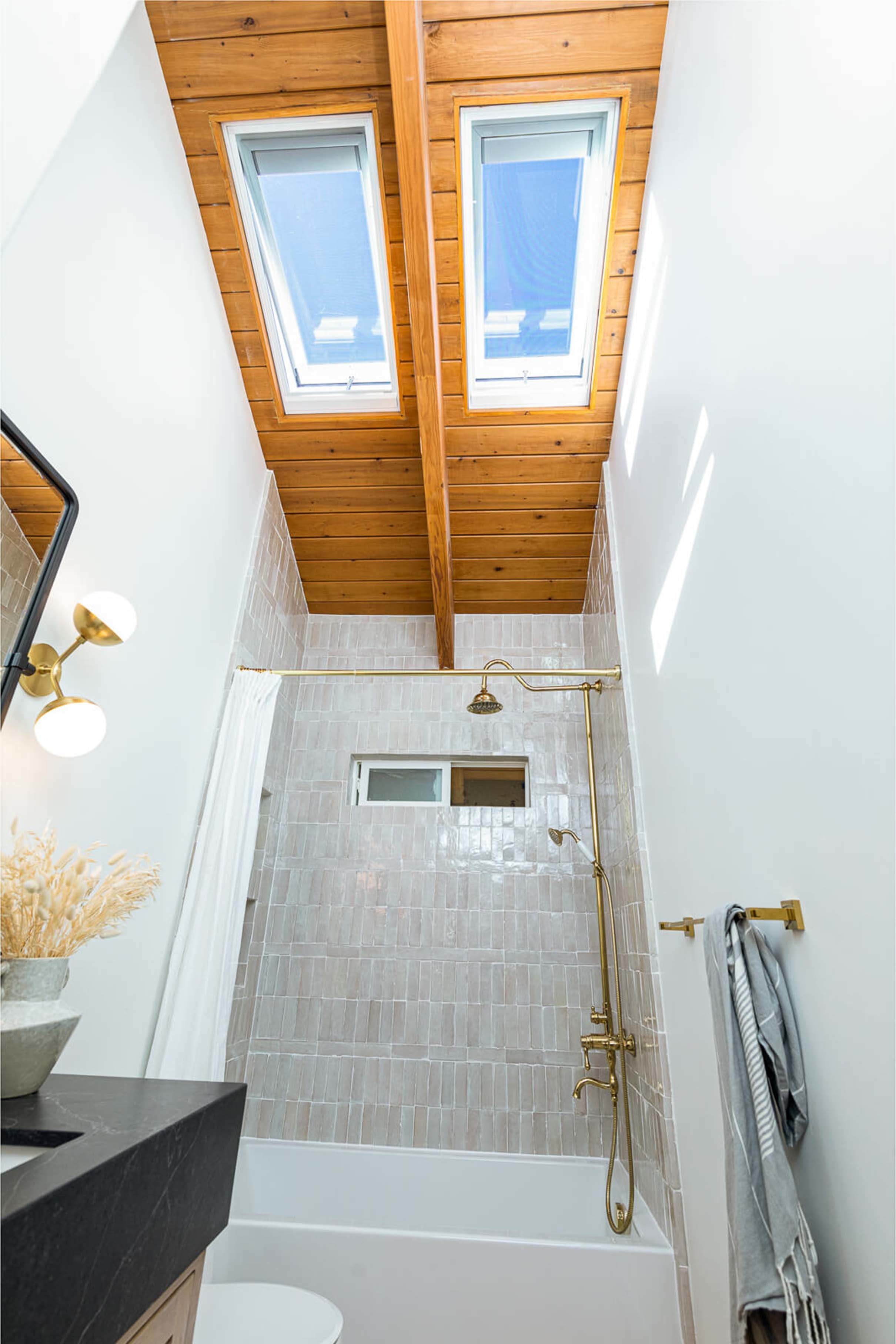 Small bathroom two skylights wooden ceiling