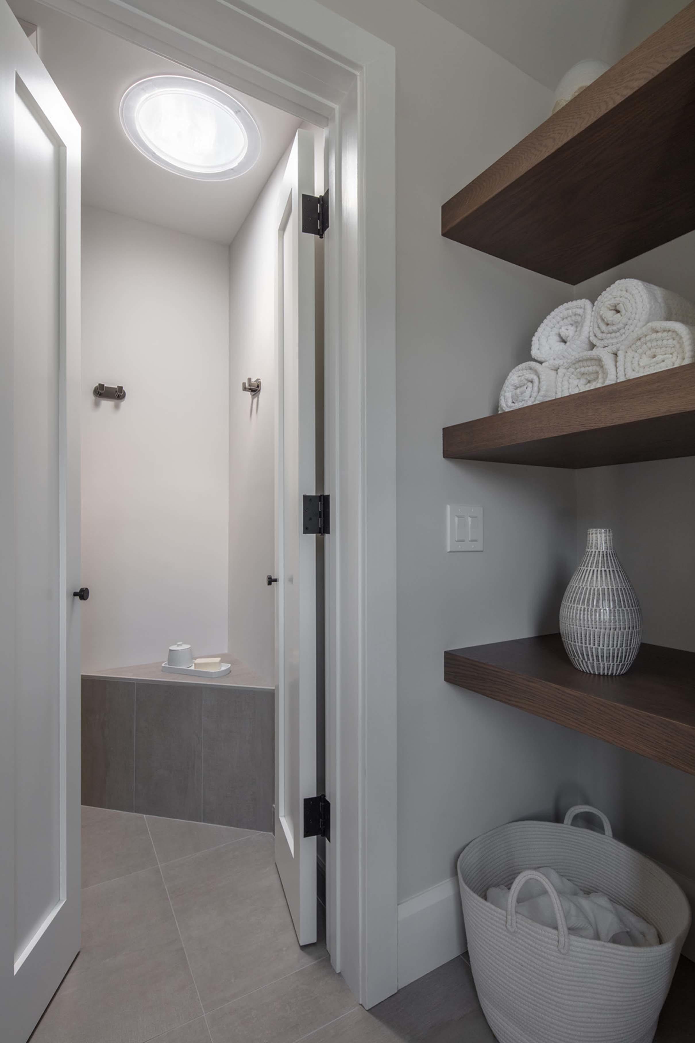 Small bathroom white Sun Tunnel skylight