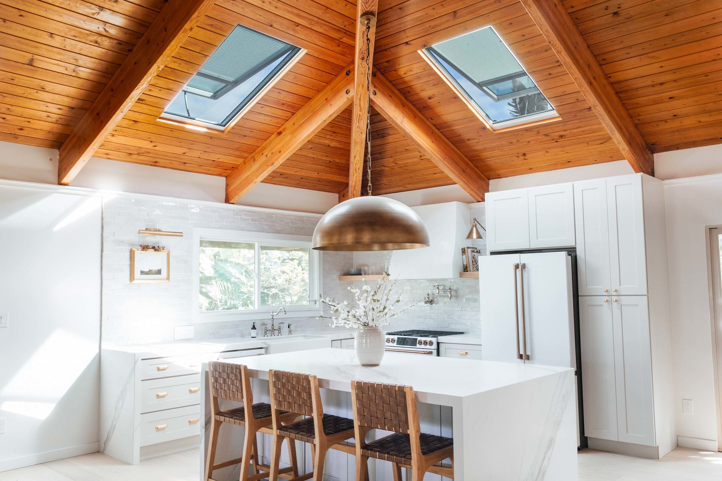 White kitchen skylights natural wood ceiling tmb