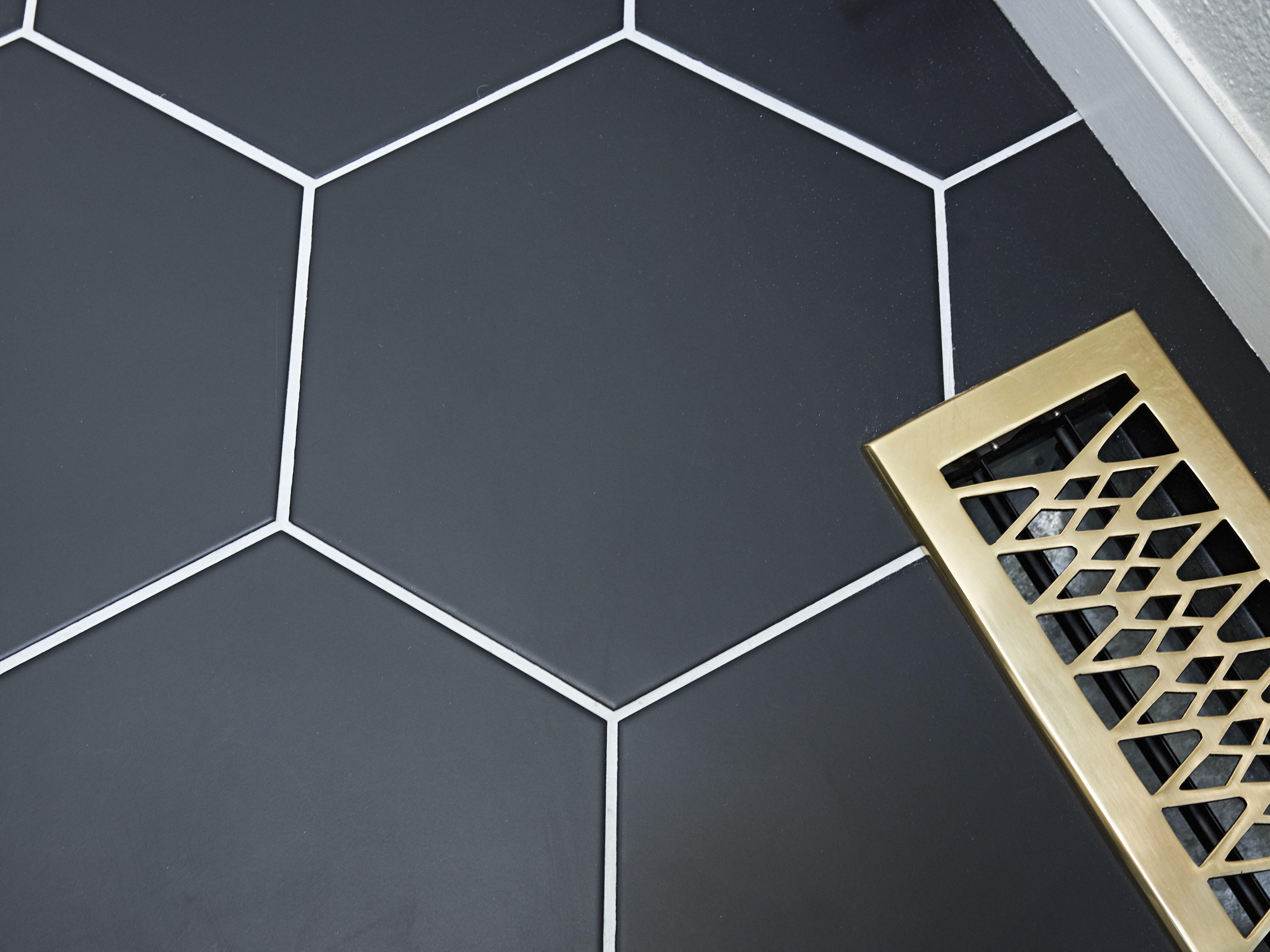 Black-octagonal-floor-tile-brass-floor-plate.jpg#asset:4486