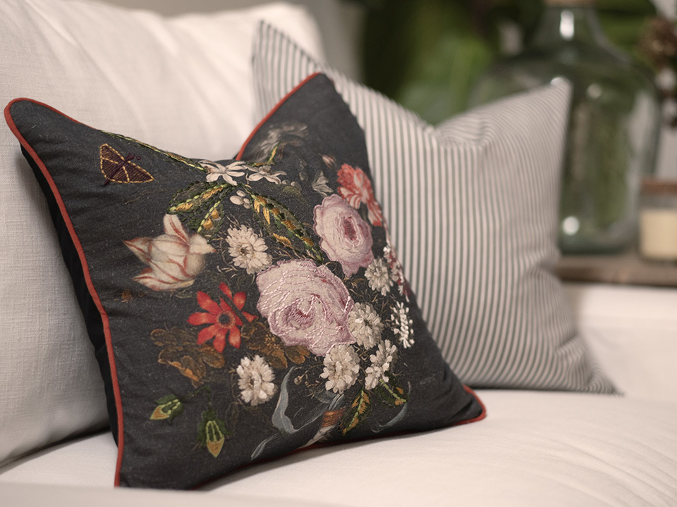 Floral-and-striped-pillows-on-a-white-couch.jpg#asset:4391